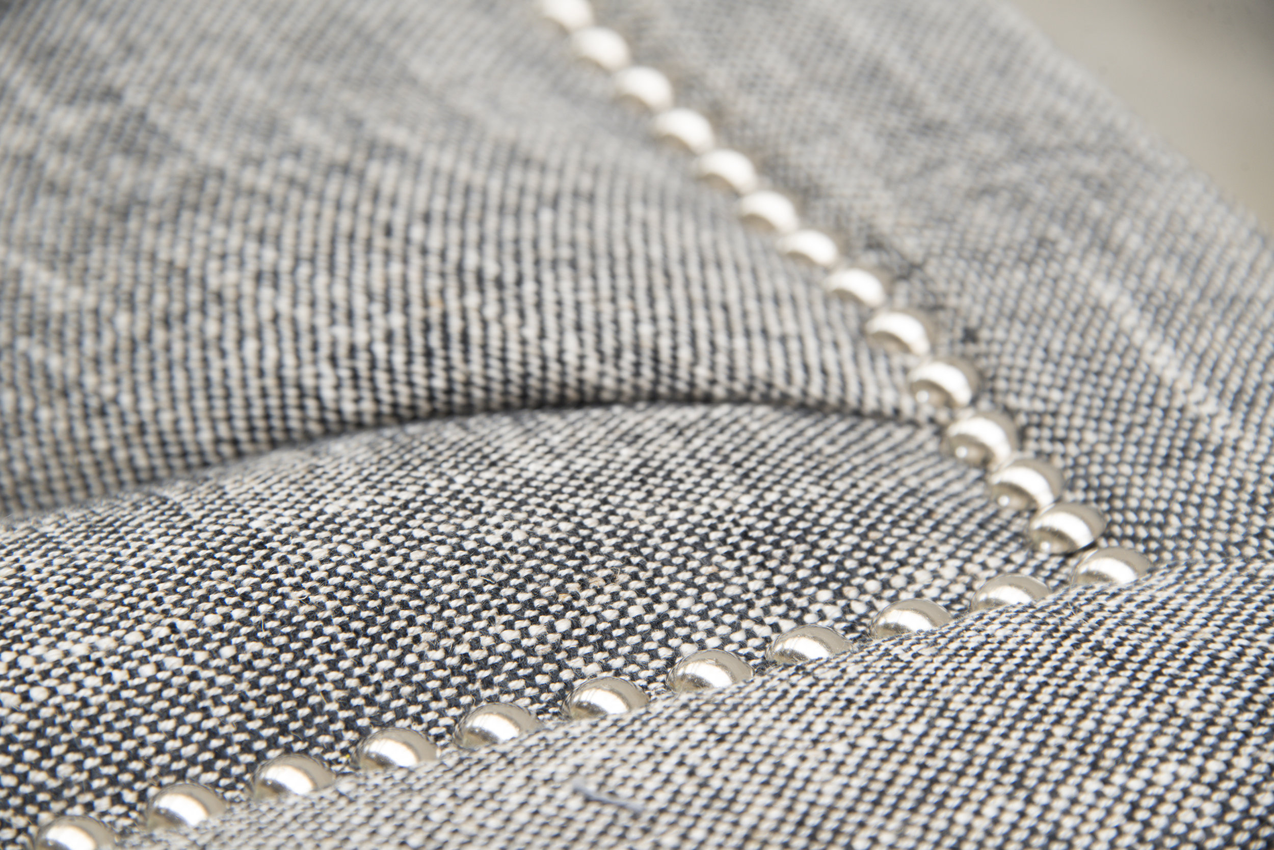 Selection of stud detailing or piping in fabric choices galore.