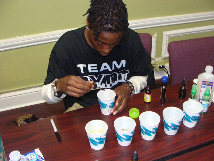 Community Youth Development Institute Student Mixing Chemicals