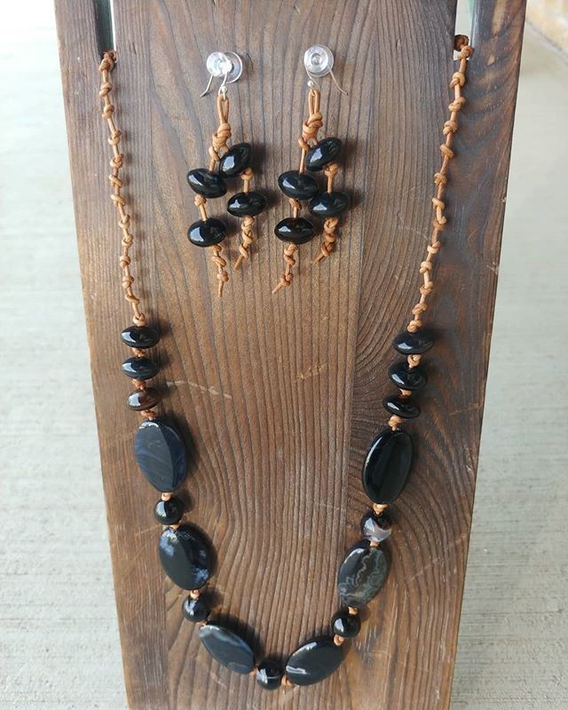 Agate stones and leather. Has a button closure. The earring hooks are sterling silver plate. $45 comment sold to purchase.