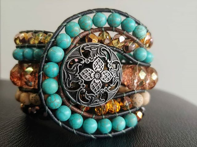 Haven't made one of these bad boys in a while! This beaded cuff style is the most time consuming and tedious design I make. The bracelet is almost 2 inches wide, made to fit a small to medium sized wrist( 6 to 7 inch circumference  wrist)  Designed to fit snug, not adjustable. This one has large firepolished Czech glass beads in the middle, also Czech glass flanking the edges. Grain stone and magnesite make a great contrast to the faceted designer glass. $65. Comment SOLD to claim. Or order a custom cuff made to fit you! #beadedcuff #cuffbracelet #hochatown #brokenbow #beadedleather #leathercuff #bohojewelry #handmade #hempgalore