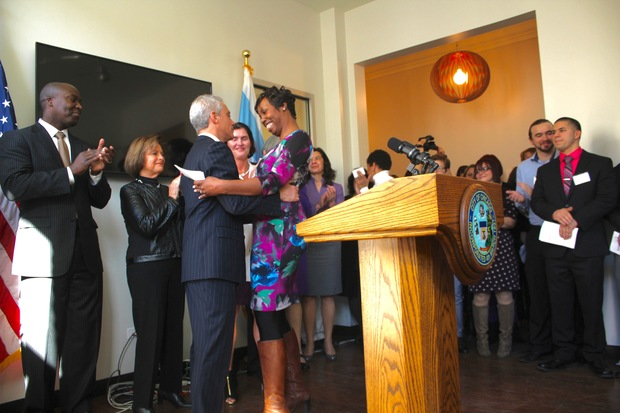 Embracing Rahm Emmanuel after giving a speech, sharing my story at the Wings Metro Event, February 2016