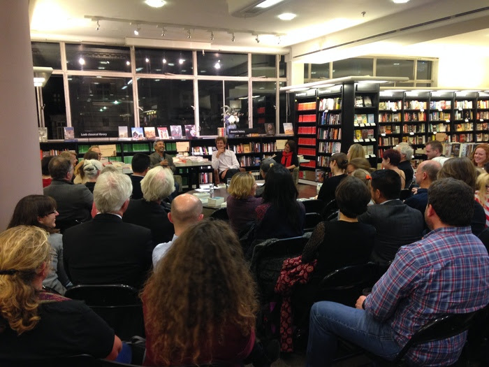 Ismailov, Barnes, and Ermakova speak to a packed house