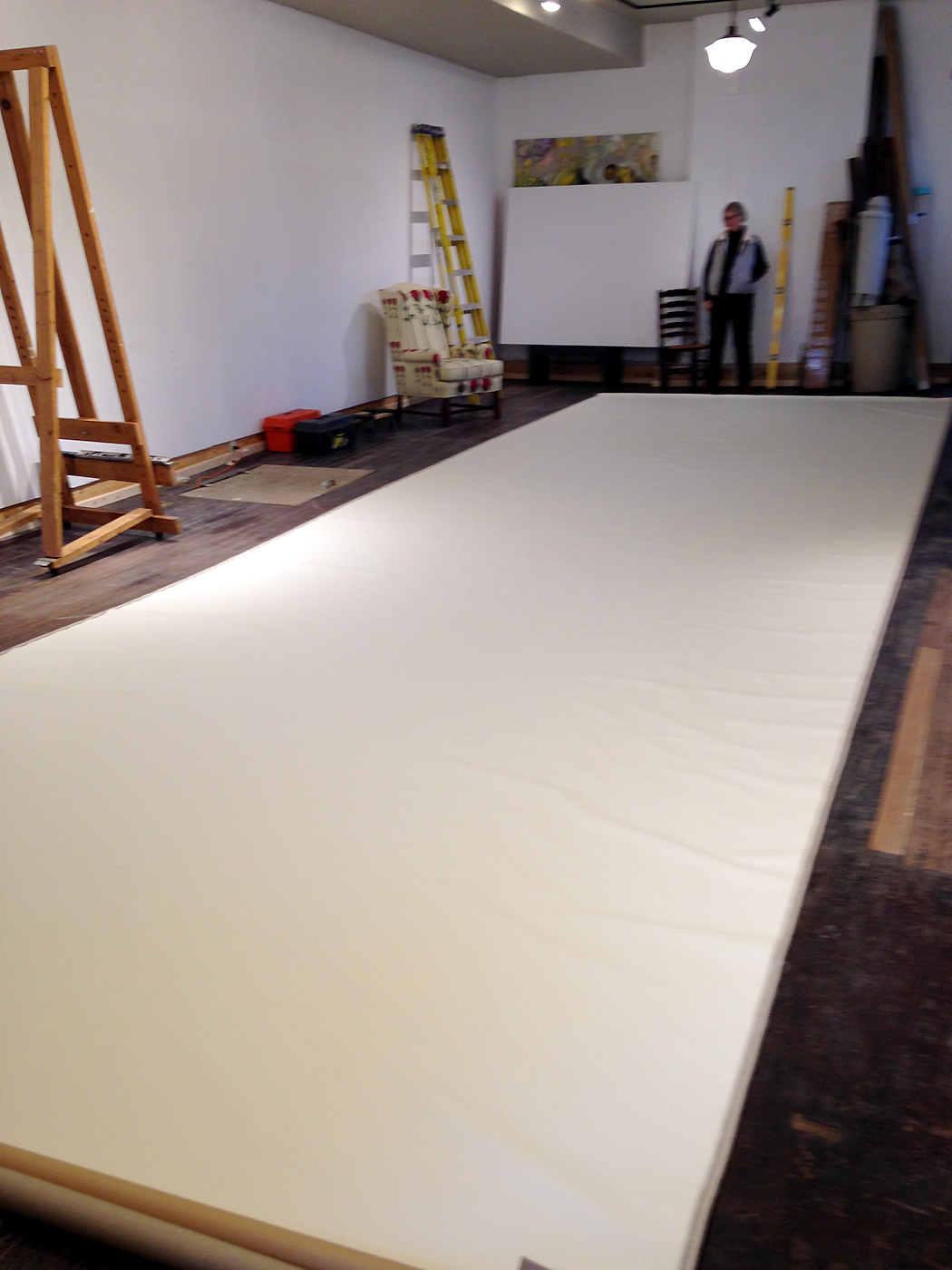 Garner in her studio with a blank canvas.