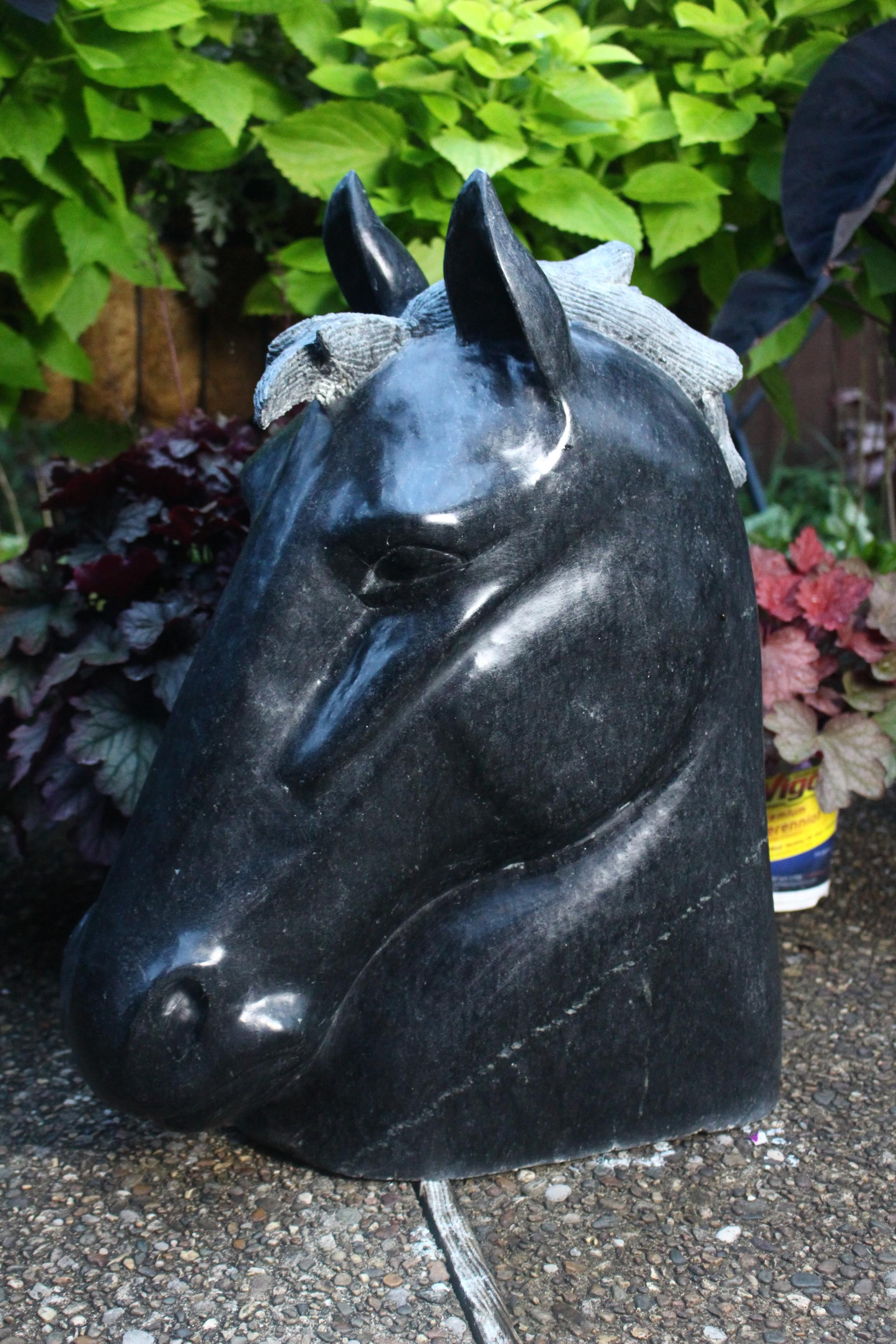 """Majestic"" by Mike McCarthy, 23.25x20x13in, Black Pearl Soapstone, $3000 
