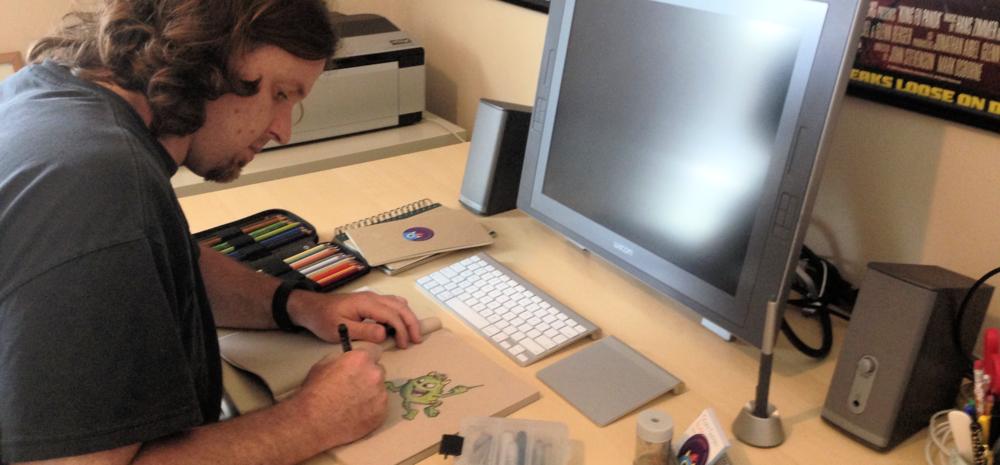 Photograph of artist Scott Soeder at work.