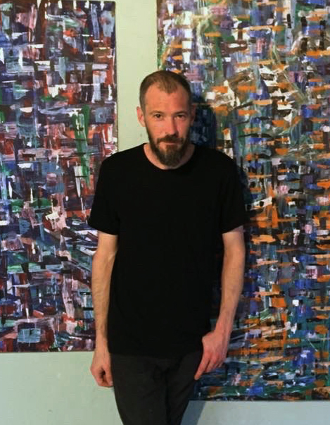 A photograph of artist  Jeremy Brightbill in studio.