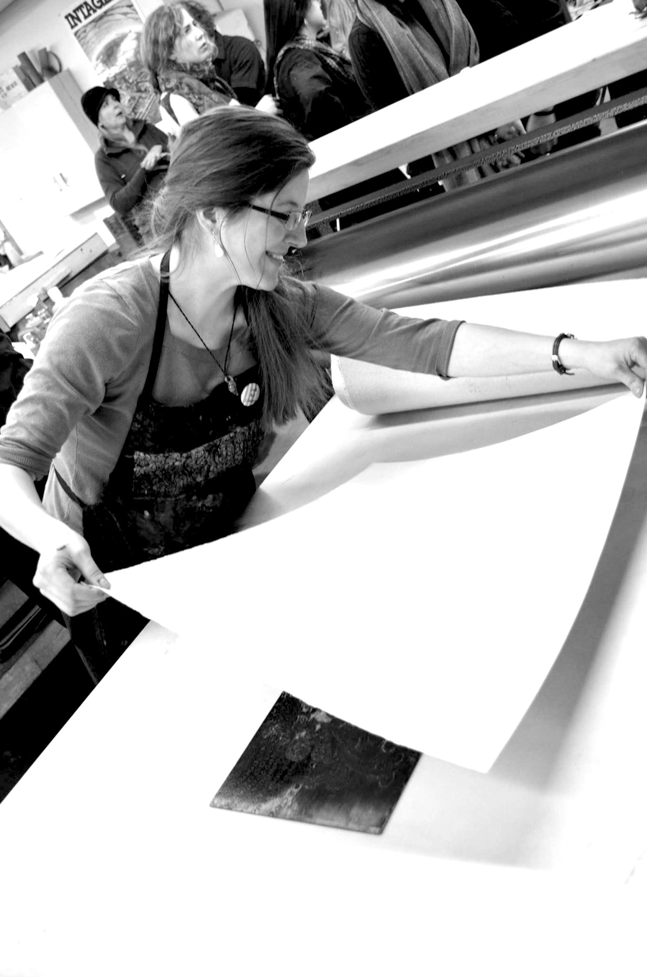A photograph of Singel at work in her studio.
