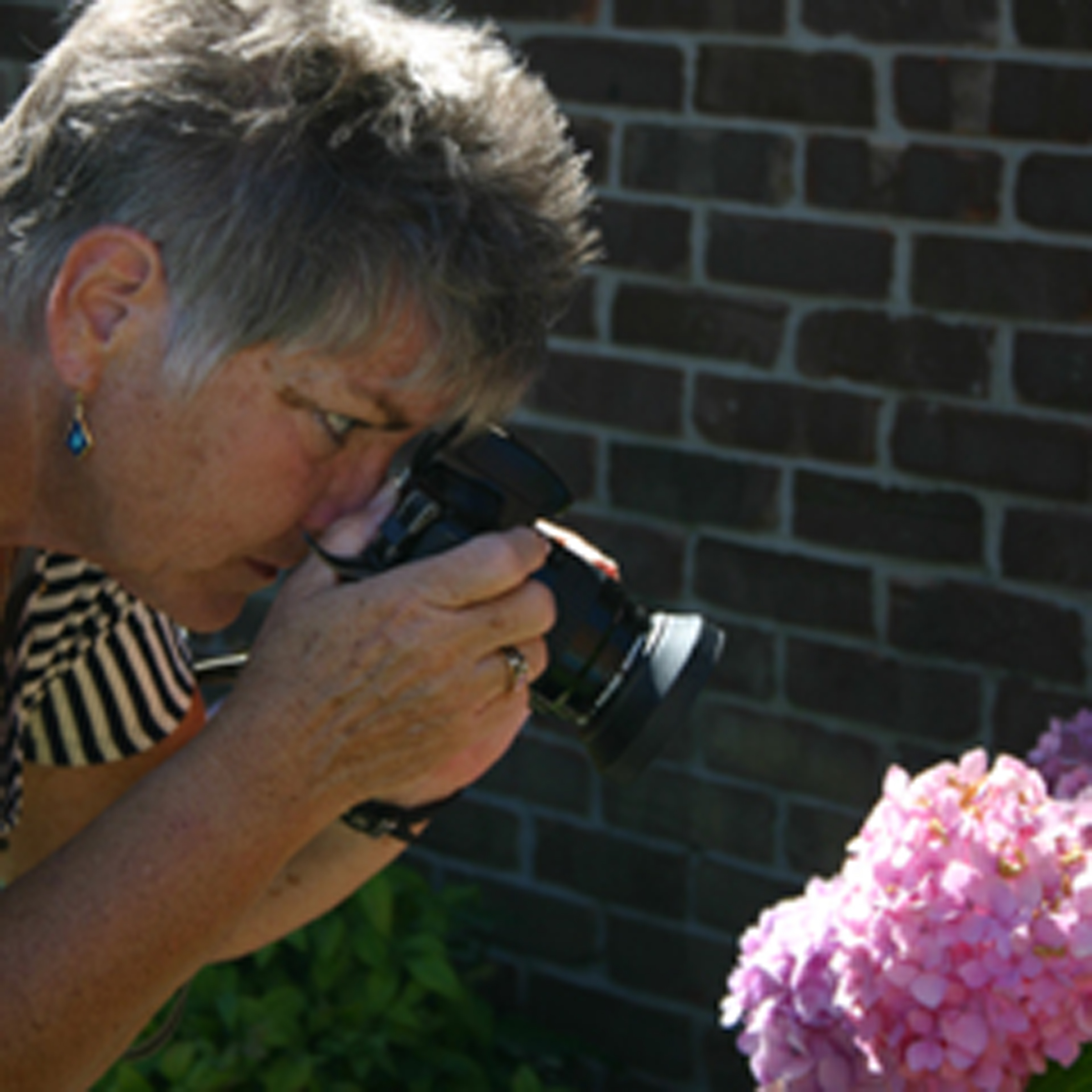 Patricia Brock taking a photo with her camera.