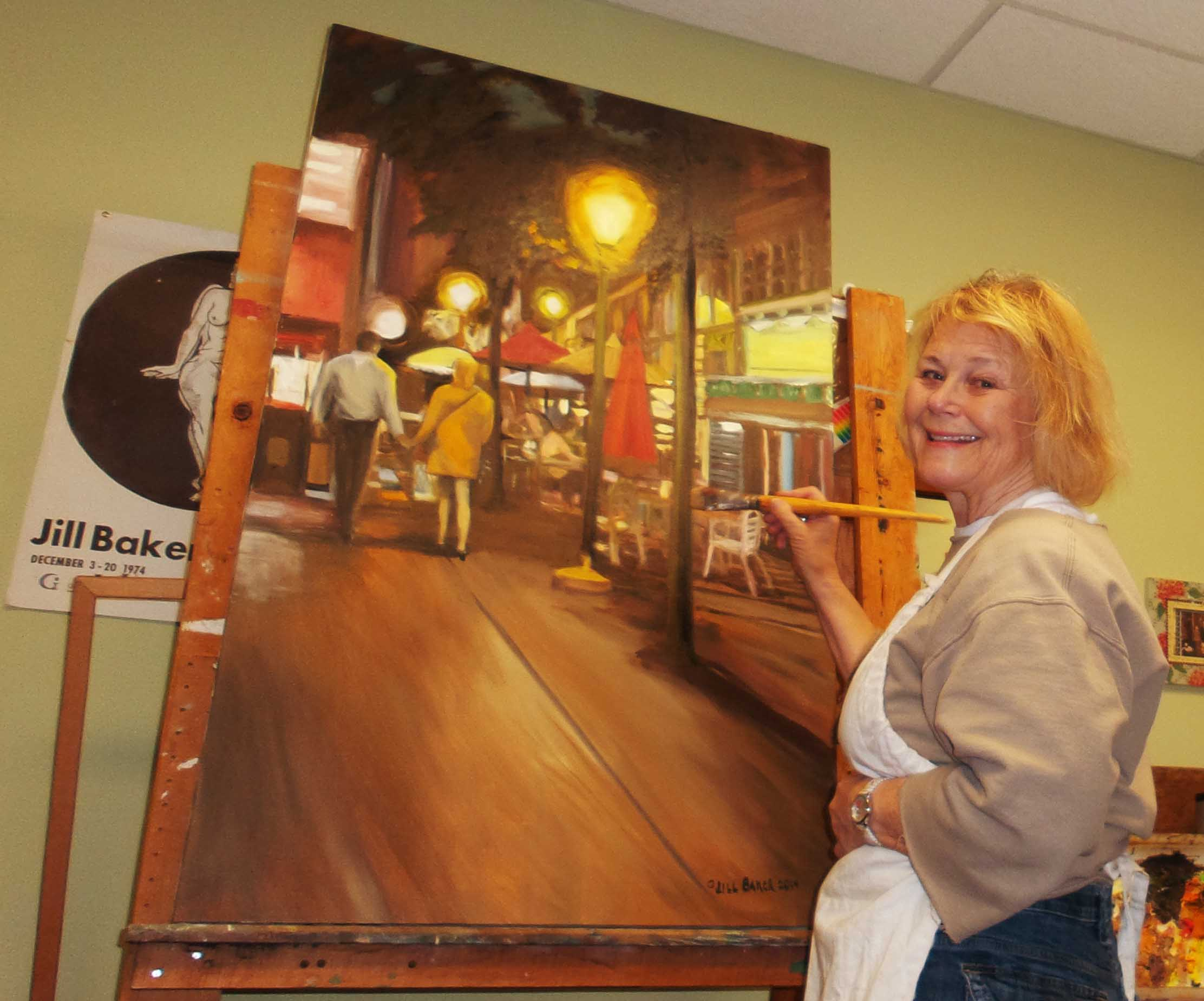 "Jill Baker working on her painting ""Summer Sidewalk In Paris"""