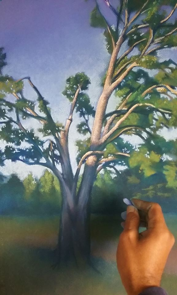 "Victor Sweatt working on his pastel drawing, ""Early Fall"""