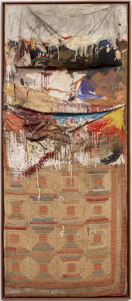 """Bed"" by  Robert Rauschenberg  75.25x31.5x8in, oil and pencil on pillow, quilt, and sheet on wood supports (1955) © 2017 Robert Rauschenberg Foundation"