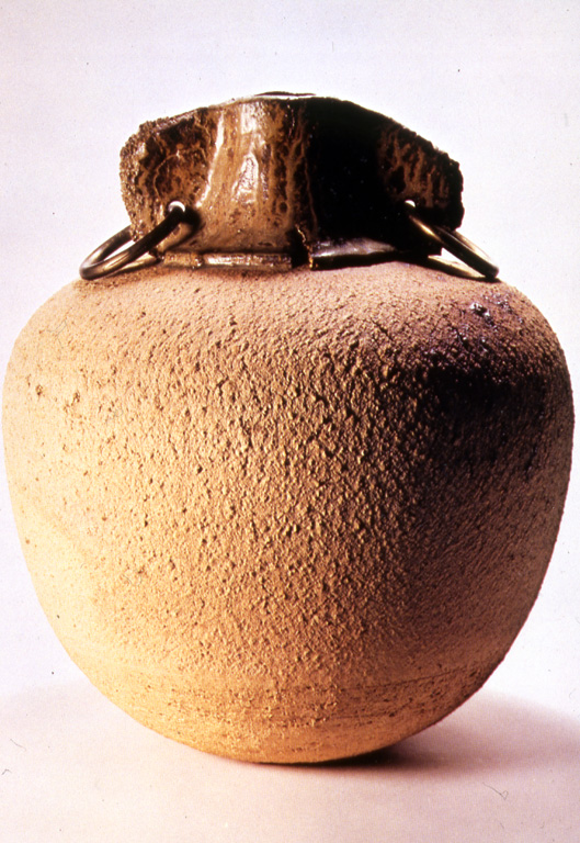 """Vase with Brass Rings"" by Marsh Pottery, 14in H, coarse stoneware   (1973). Photograph courtesy of the Hite Art Institute."