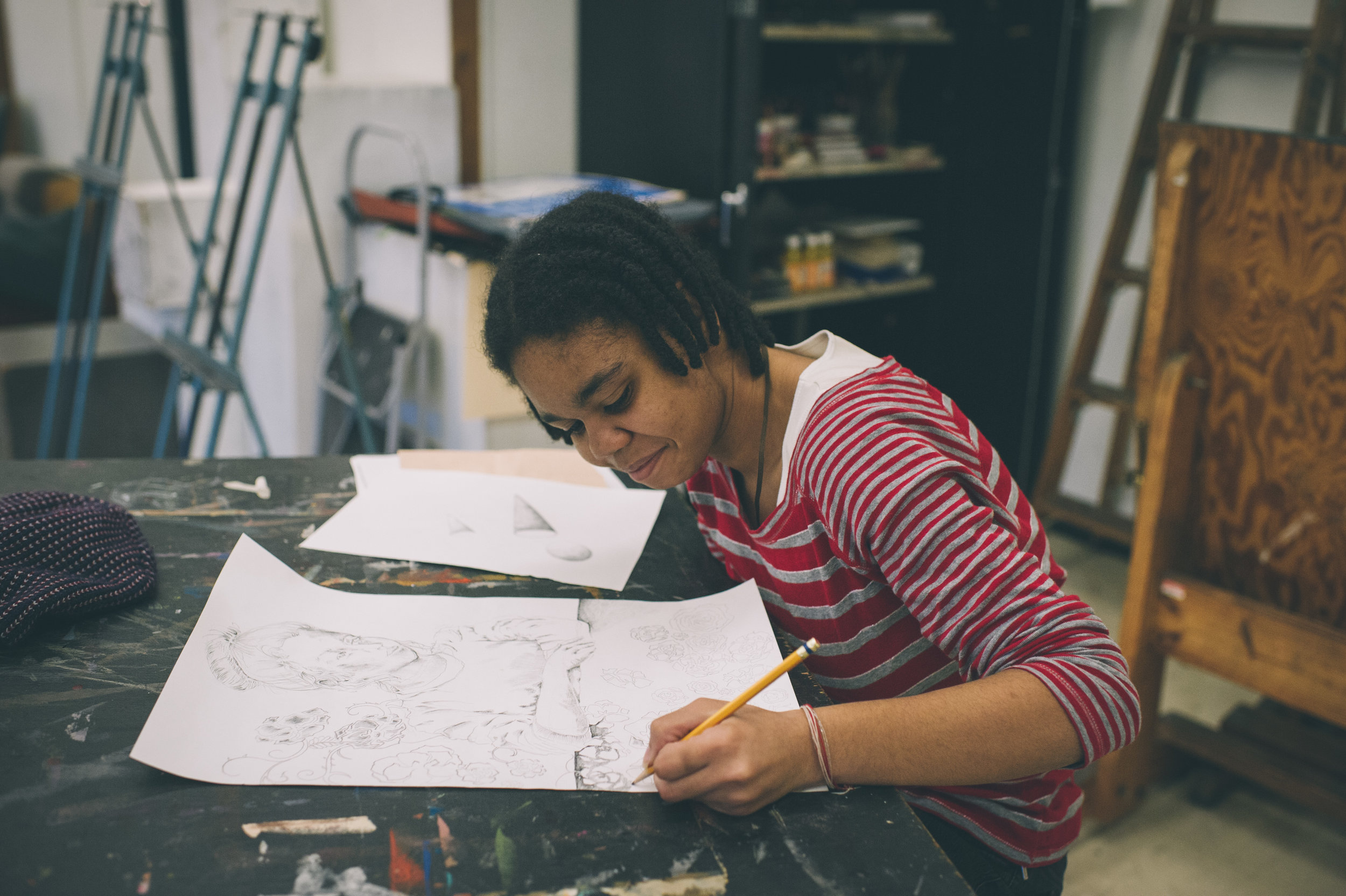 Student, Mayteana Williams working on a drawing.