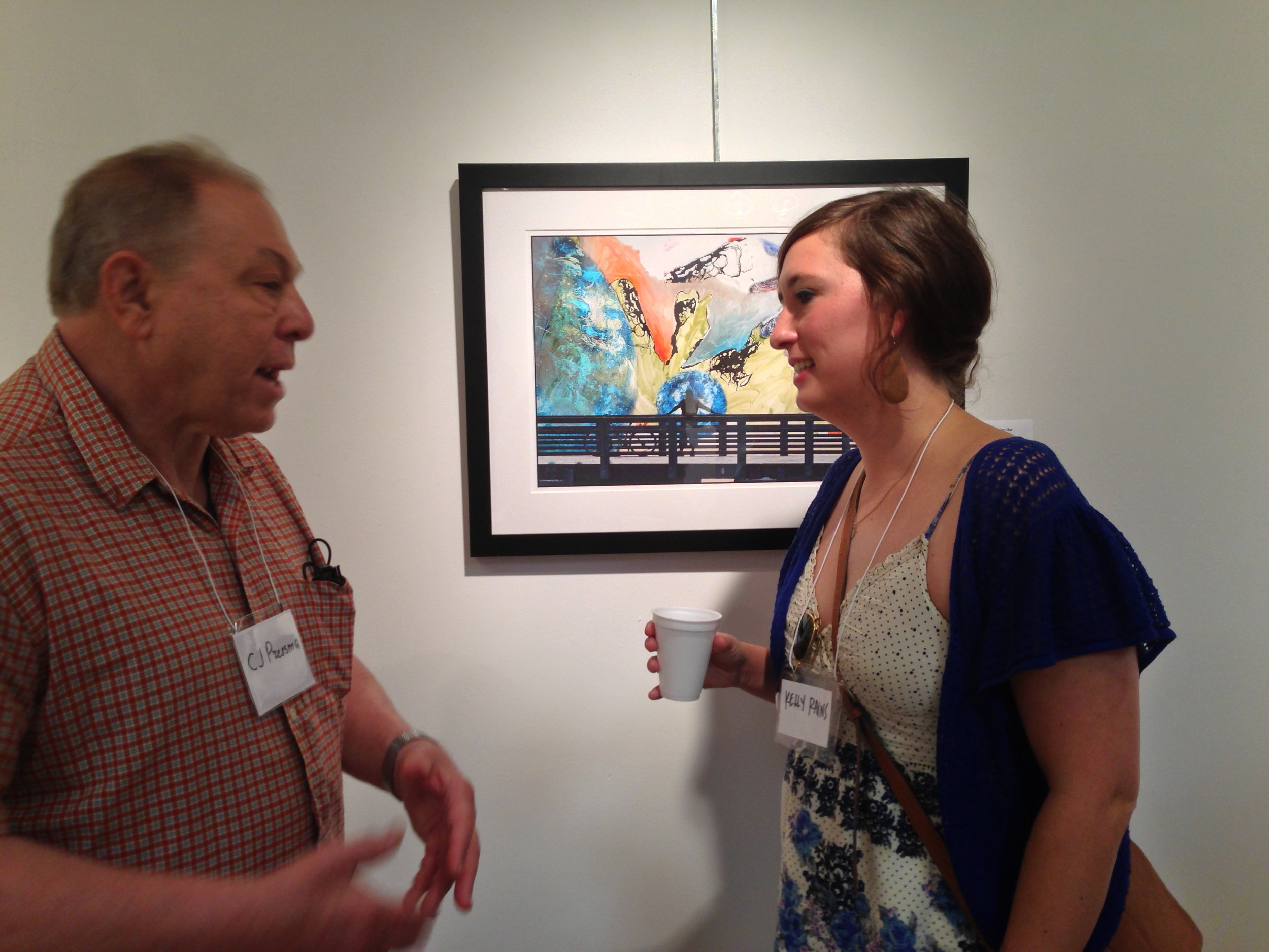 C.J. Pressma & Kelly Rains discuss the project in front of their piece. (Photo courtesy of Kelly Rains.)