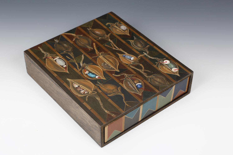 """Fetish Box III"" by Wendi Smith,Acrylic on reclaimed cigar box, pod, beads, thread,6.25x5.75x1.5in, 2016"