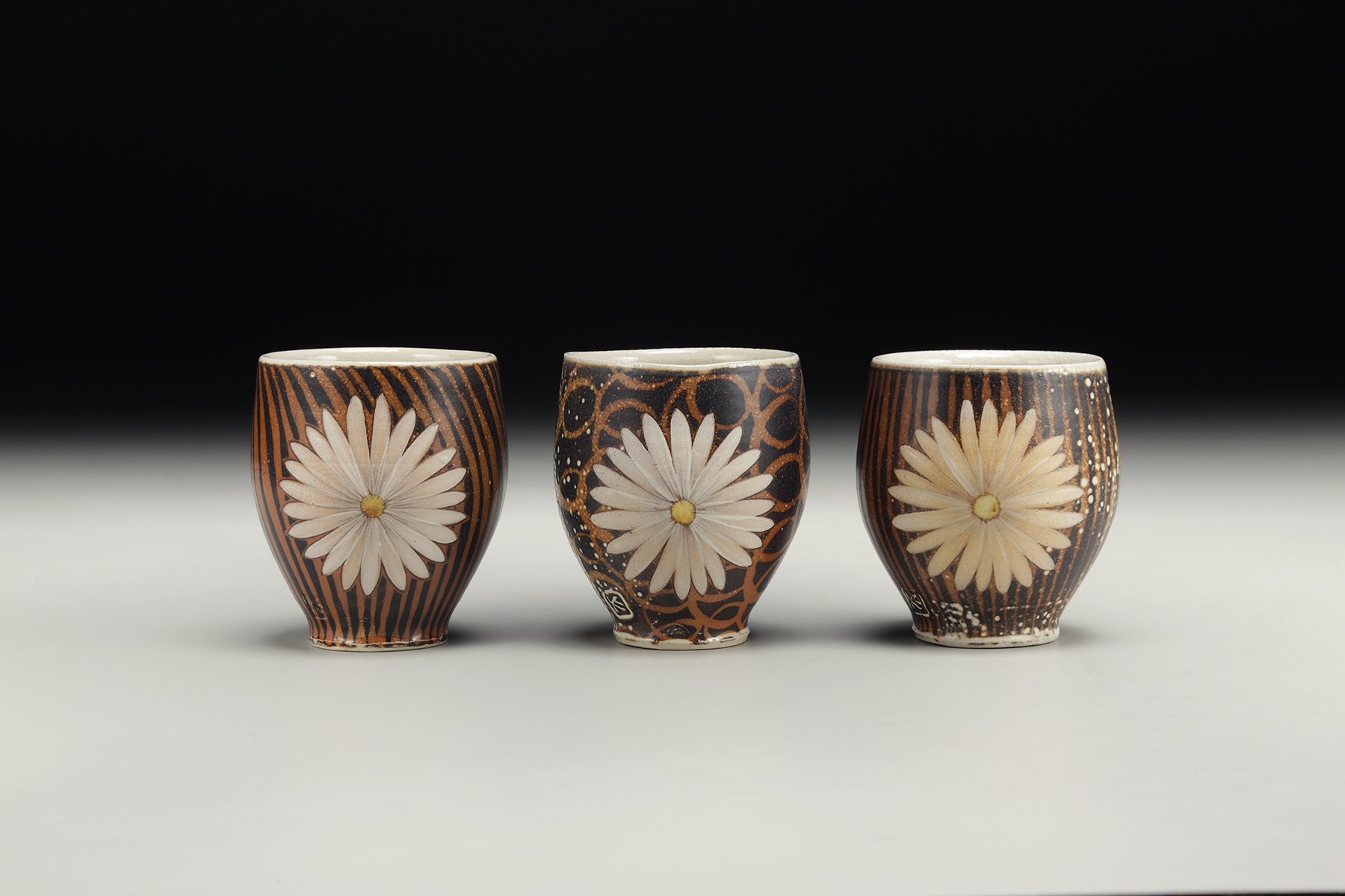 """""""Daisy Cups"""" by Kyle Carpenter, Stoneware, 4x3in, 2017, POR"""