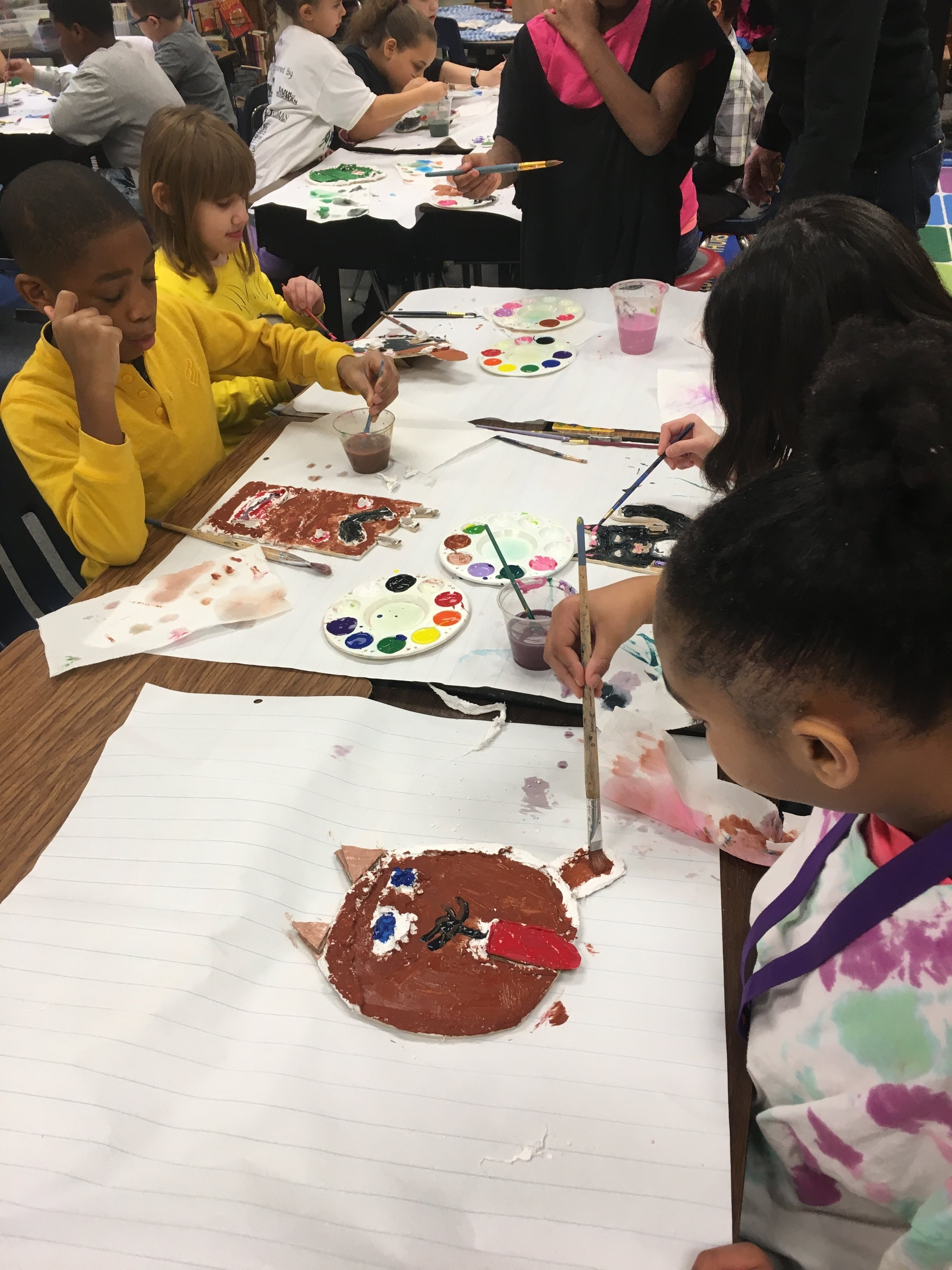 We've been having a wild time at Field Elementary School making masks with the third grade! These creative students used wood, plaster, paint, and embellishments to create these whimsical works!