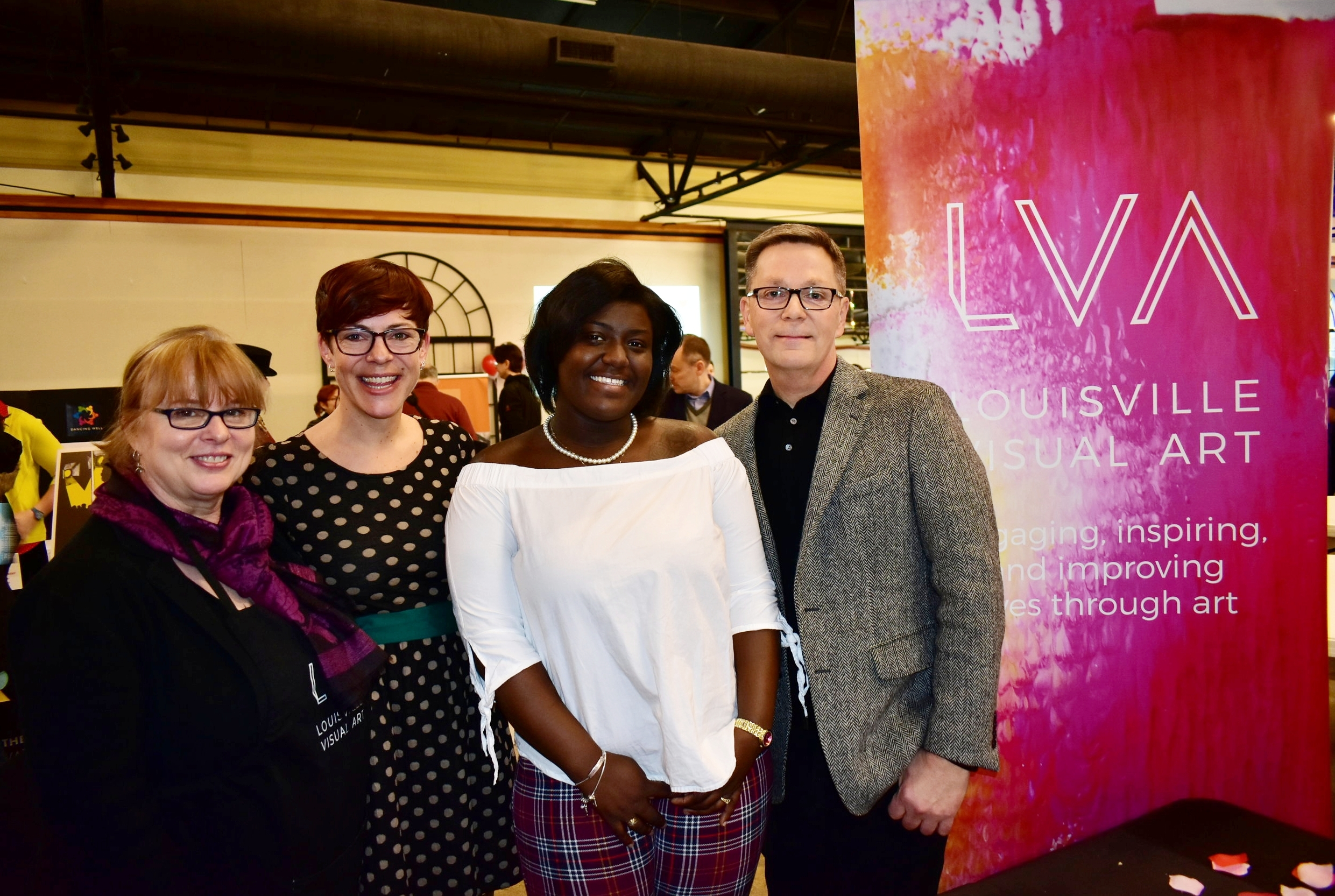 LVA's Annette Cable, Ehren Reed and Lindy Casebier with student Donielle Pankey