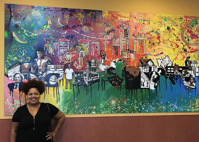 Ashley Cathey at the installation of her mural for the Kroger on West Broadway. Photo: Sarah Katherine Davis Photography.