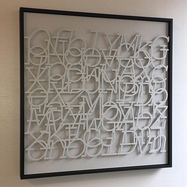 """Sonnet"" by Steve Heine, random text, laser-cut steel, small-diameter magnets, primer, poplar, 30x30x2in, 2019, $3900"