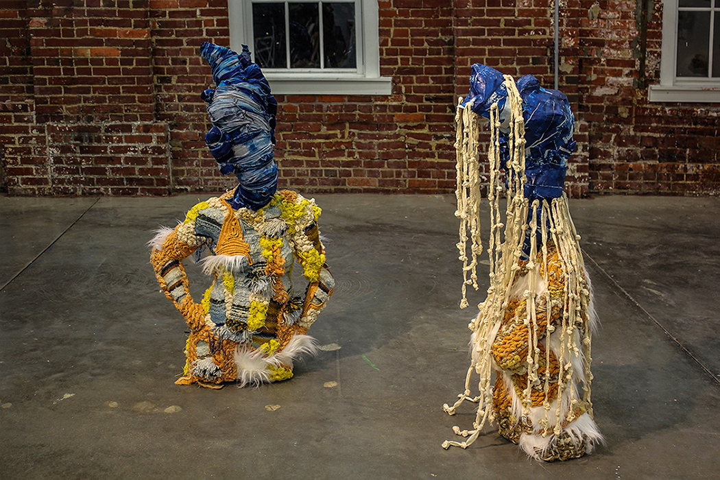 """Sisters My Lady of Charity (left) and Our Lady of Regla (right)"" by Amalia Galdona Broche, Fiber installation, 58x40x25in / 50x20x20in, 2018"