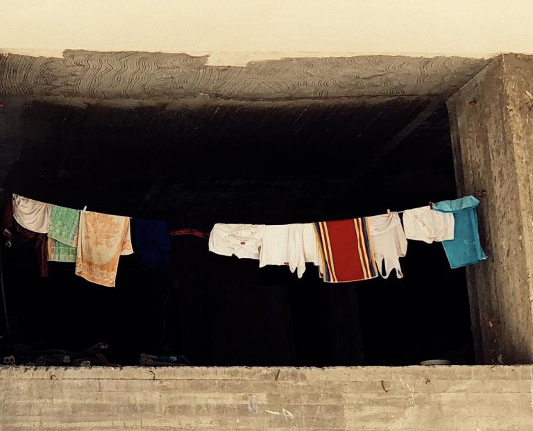 Daera Alley |  July 29, 2018 Port Said, Egypt | A string-line of wet laundry displayed facing the street.