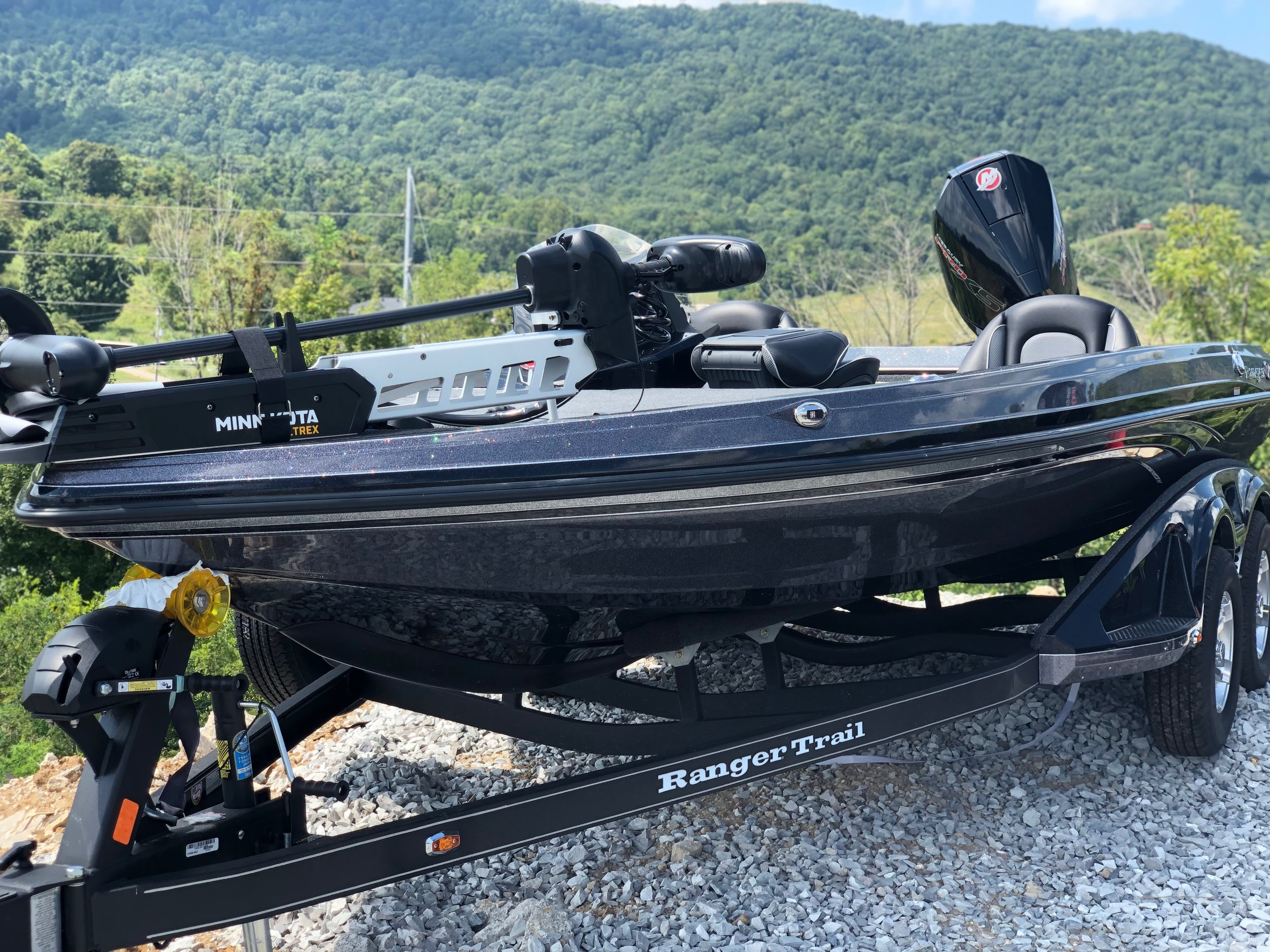 Ranger Z519 - This 2020 all black Z519 Ranger includes, Minn Kota ultrex, two Lowrance hook depth finder, plenty of storage, extra seat, cover, trailer with extra tire, ladder, and detachable tongue on trailer. Call for Price!!! Click here for more pictures.