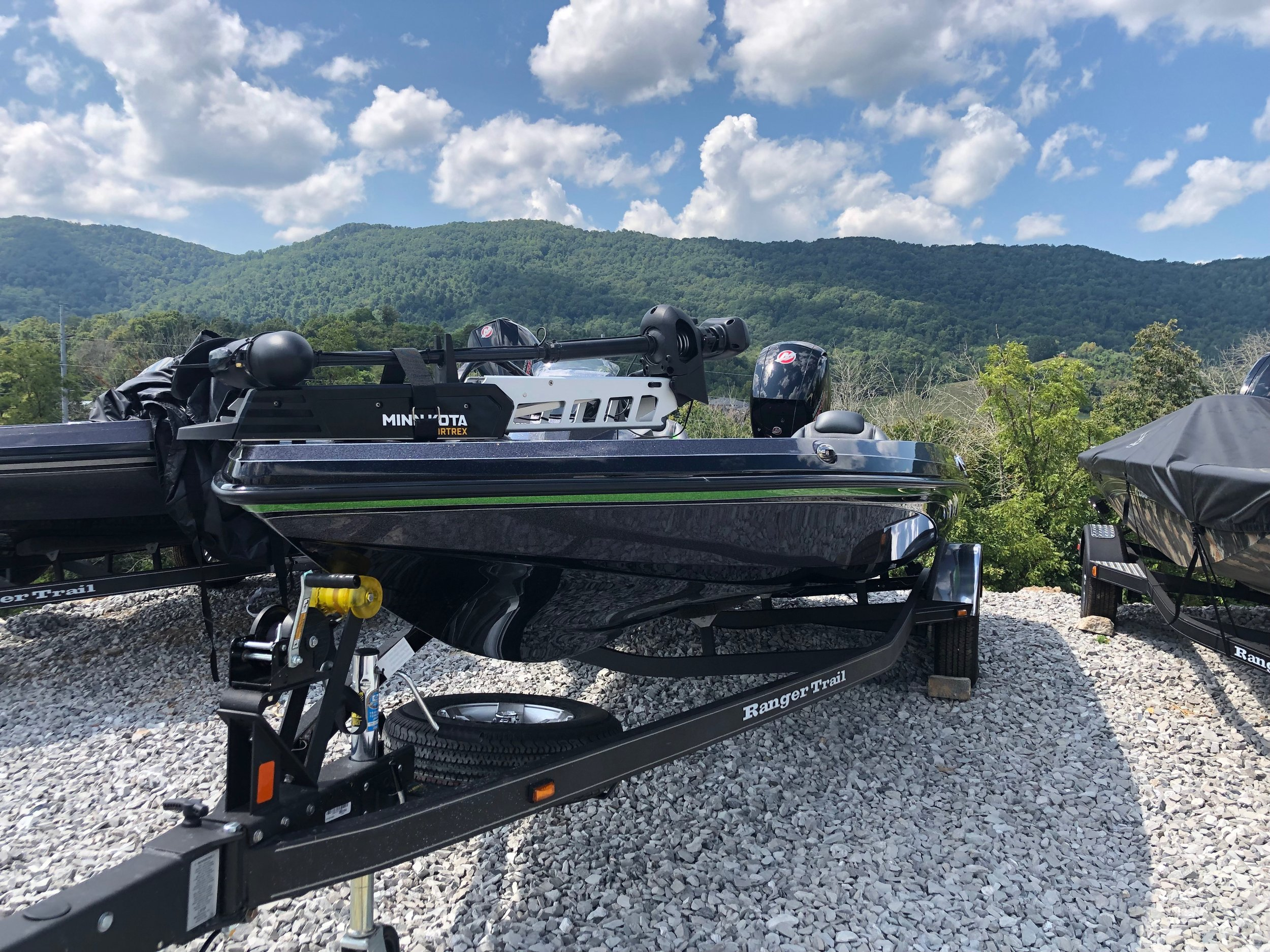 Ranger z185 - This black Z185 Ranger has green accents and includes extra seats, two Lowrance depth finders, cover, mercury 150 pro, plenty of storage, trailer, extra tire, and a Minn Kota Minn fortrex. Call for price!! Click here for more pictures.