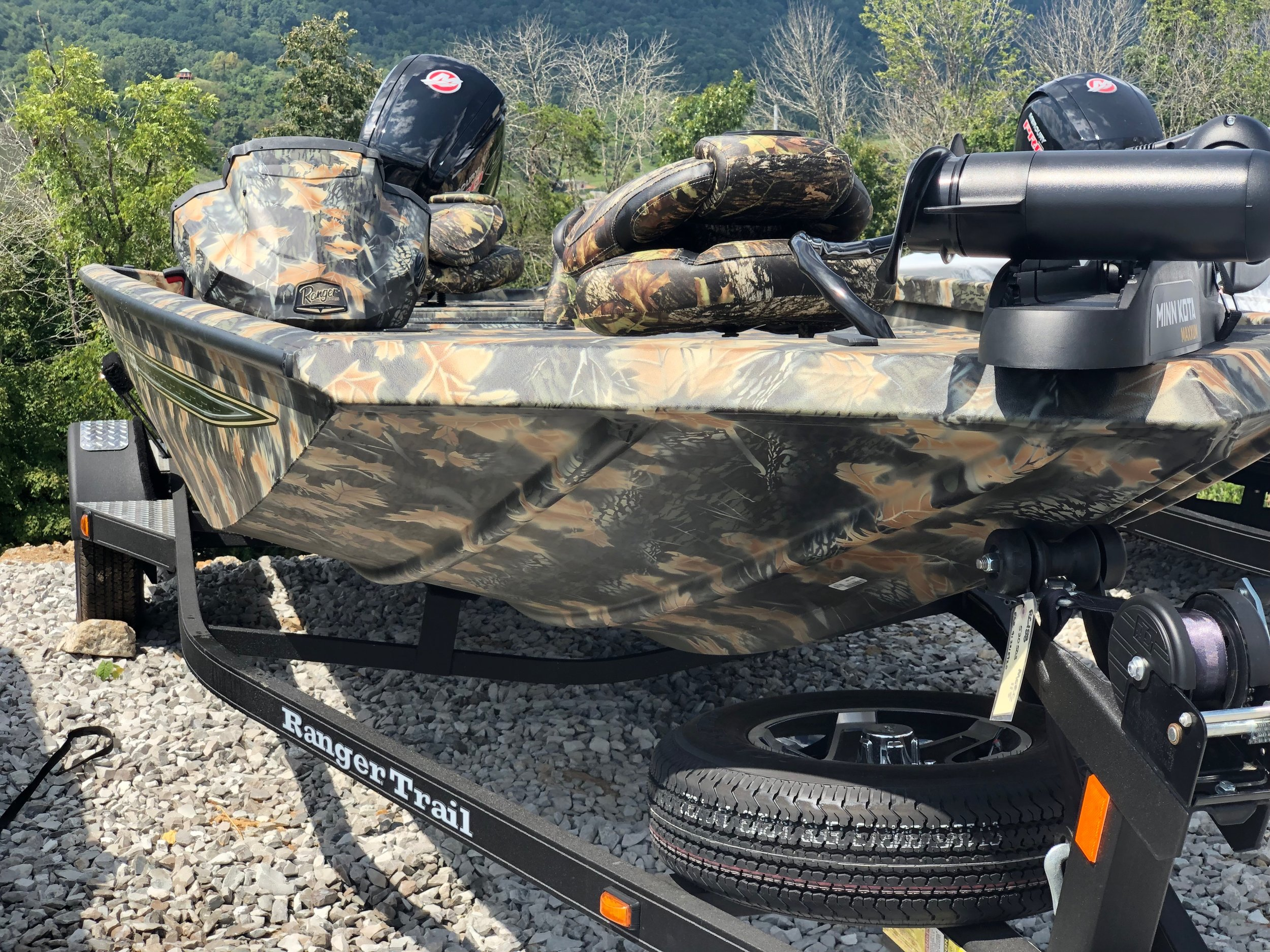 Ranger RT188 - This 2020 camo Ranger has hit the spot for all hunters and fishers and it includes, extra seat, trailer, with extra tire, plenty of storage, Lowrance depth finder, swimming ladder, Minn Kota Maxxum trolling motor, detachable tongue, cover, and a mercury 115L Pro XS. Call for price!! Click here for more pictures.