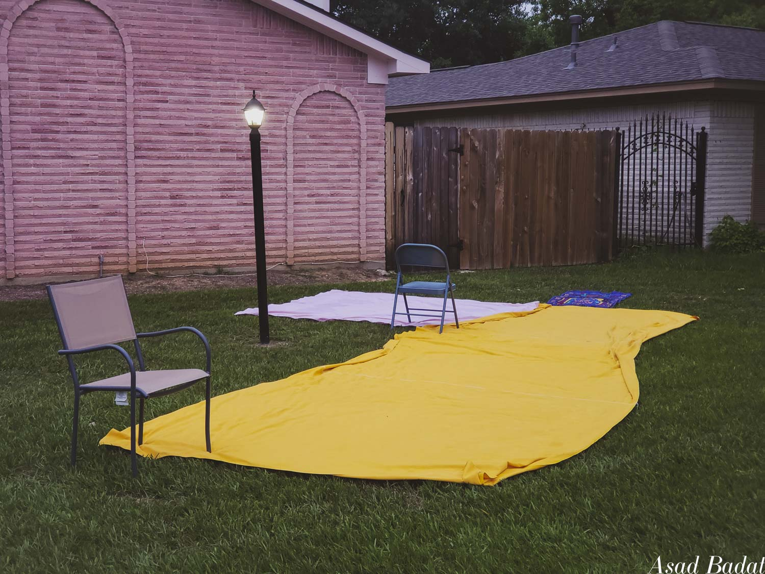 The chairs were used to pin the sheets to the ground. Also, the yellow sheet looks like American cheese.