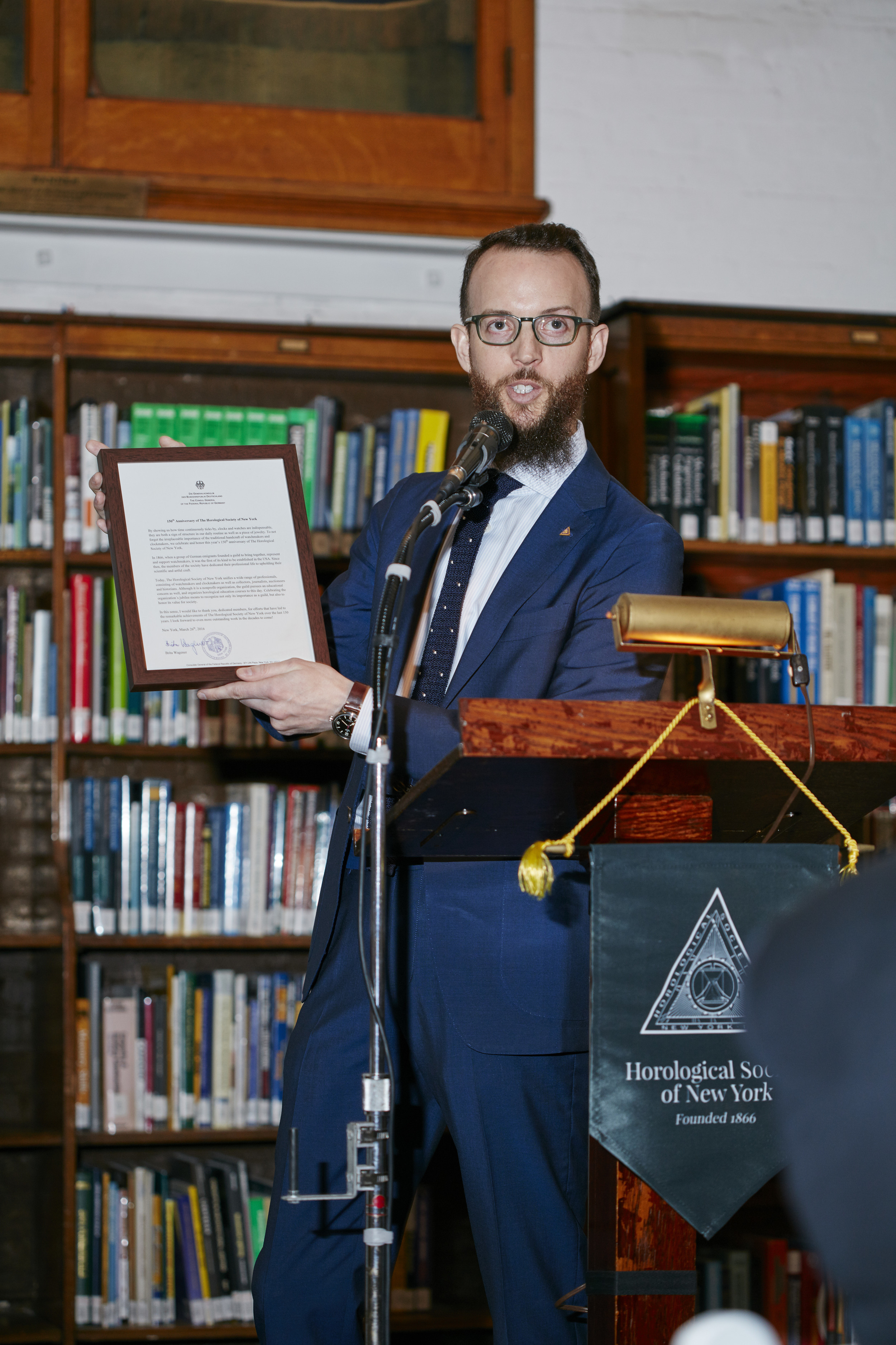 Nicholas Manousos, Vice President of HSNY, presenting a proclamation from the German government