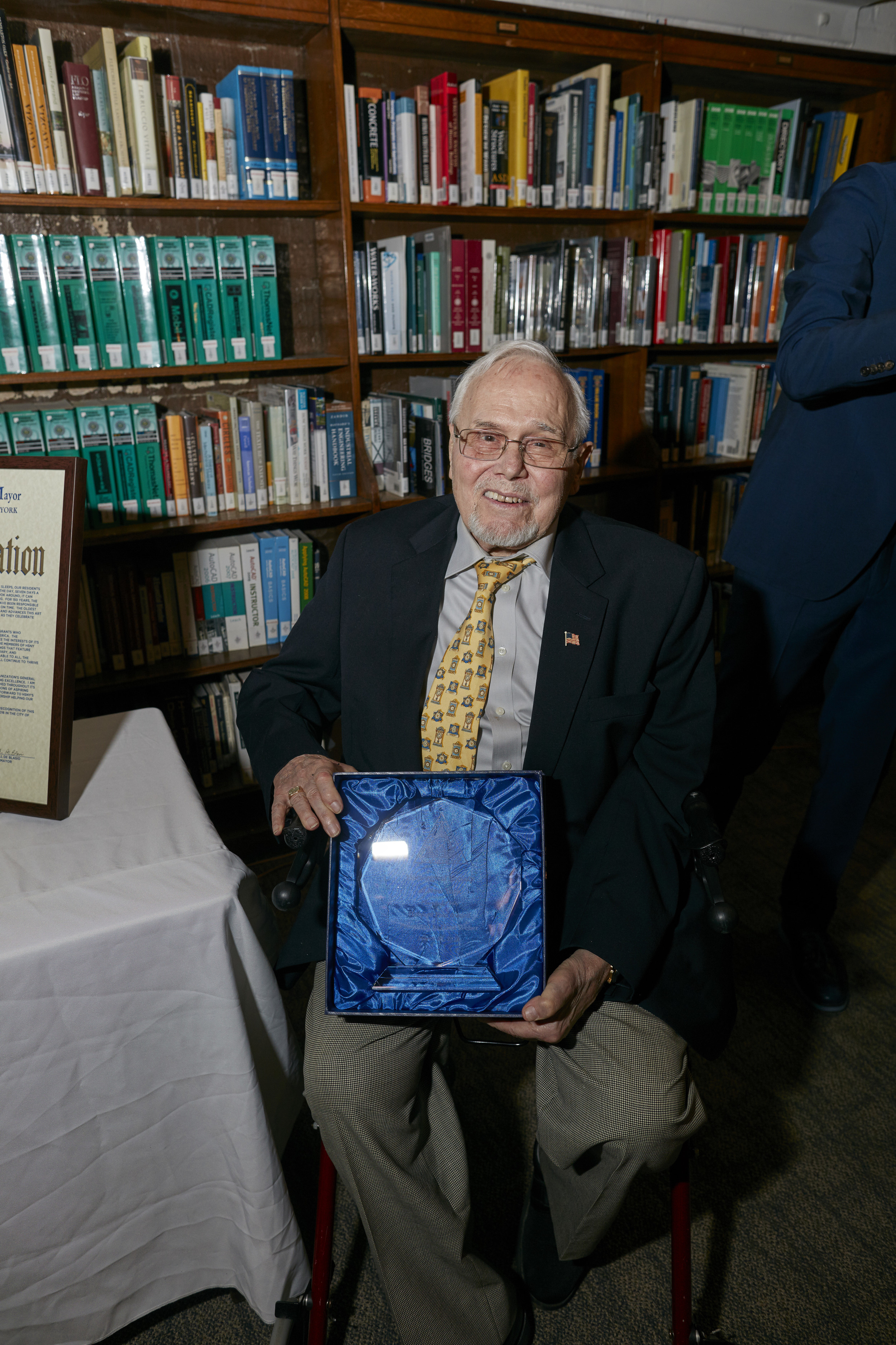 Hans Weber, HSNY Trustee & Fellow, displaying the Howard Fass Award he received earlier in the night