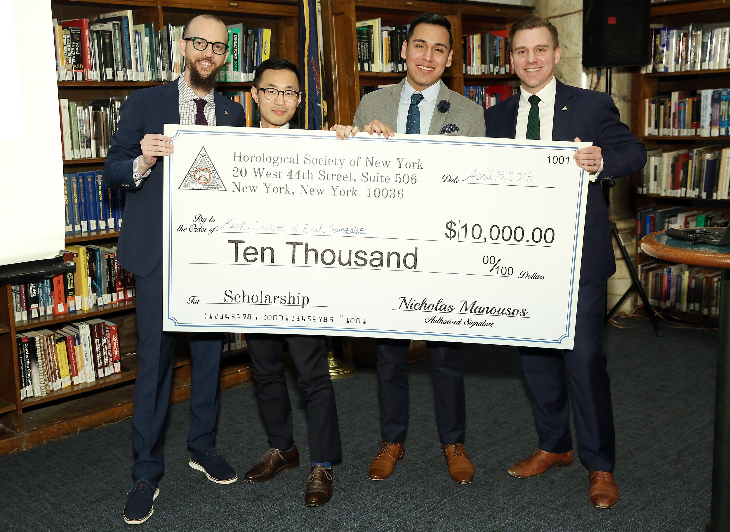 Nicholas Manousos (HSNY's President, left) and Steve Eagle (HSNY's Director of Education, right) presenting the 2018 Henry B. Fried Scholarship to Mark Duckett (middle left) and Erik Gonzalez (middle right).