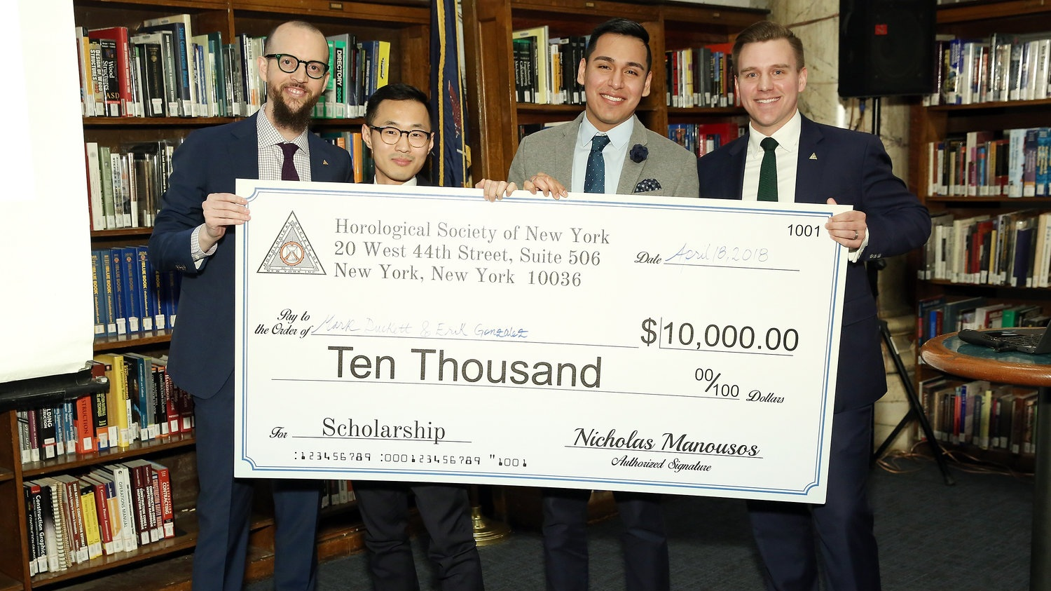 Nicholas Manousos (HSNY's President, left) and Steve Eagle (HSNY's Director of Education, right) presenting the 2018 Henry B. Fried Scholarship to Mark Duckett (middle left) and Erik Gonzalez (middle right), students at the Patek Philippe New York Watchmaking School .
