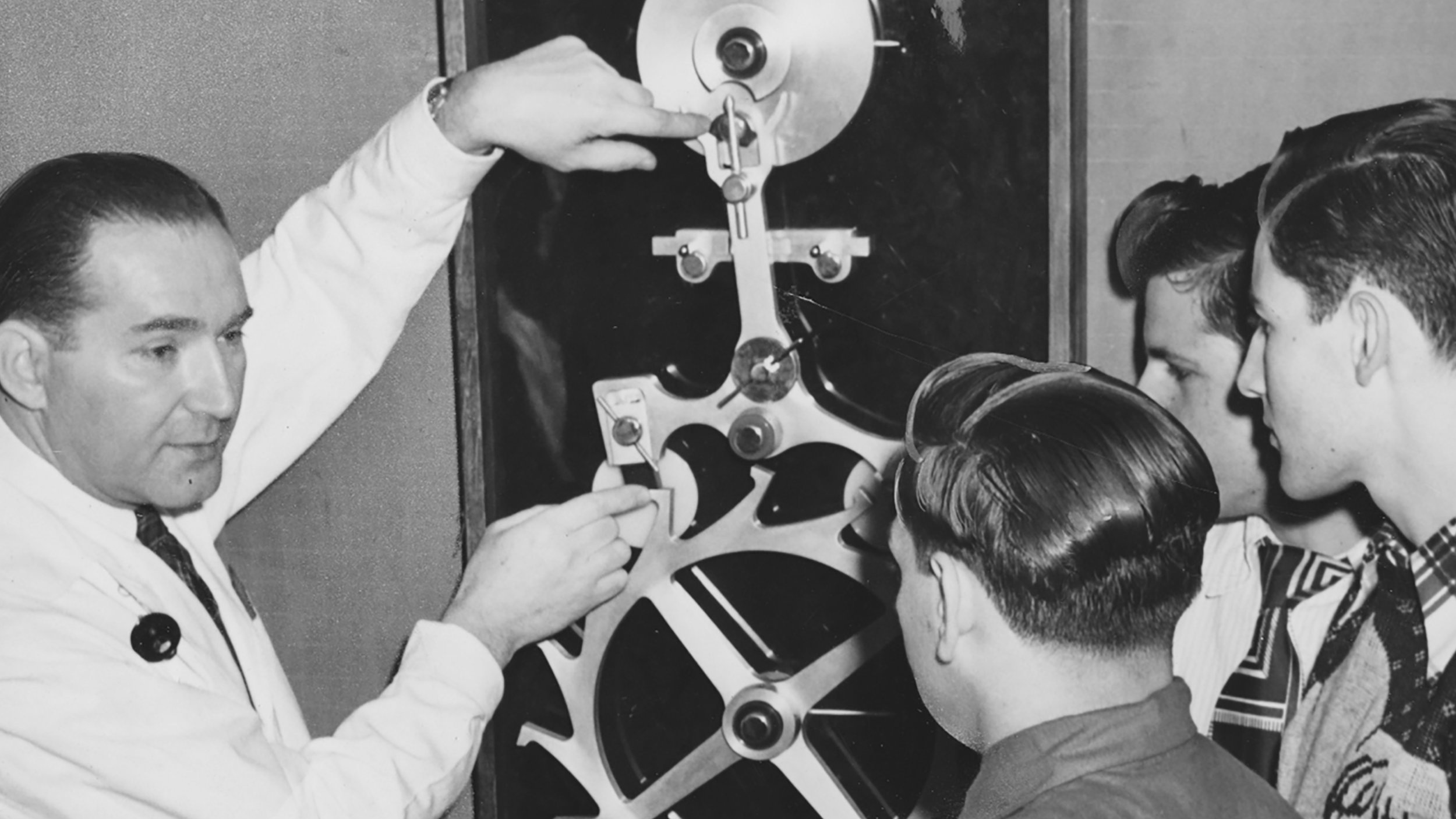 Henry B. Fried instructing students on escapement mechanics. Photo courtesy of the    Brooklyn Public Library—Brooklyn Collection   .