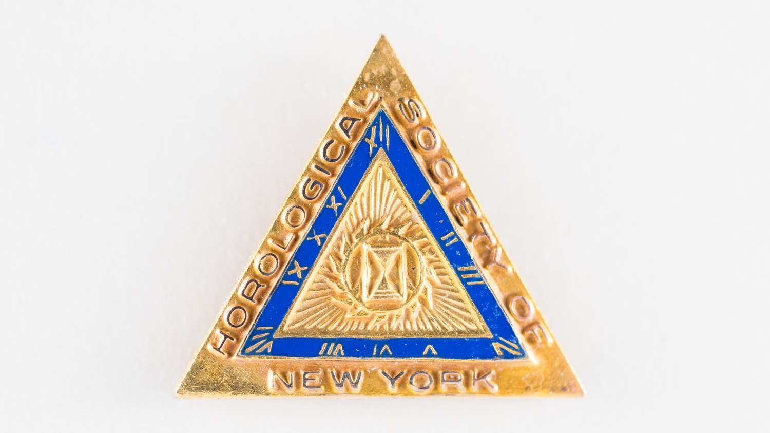 Lot 1 - Horological Society of New York Vintage Lapel Pin, Circa 1930  Only a handful of these original pins still exist. Gold-filled, brand new, never worn.  Estimate: $1,000 - $2,000