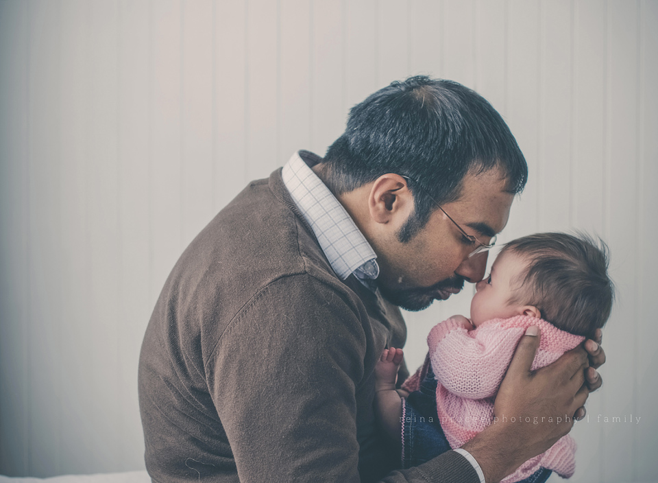 father nose to nose with two month old daughter