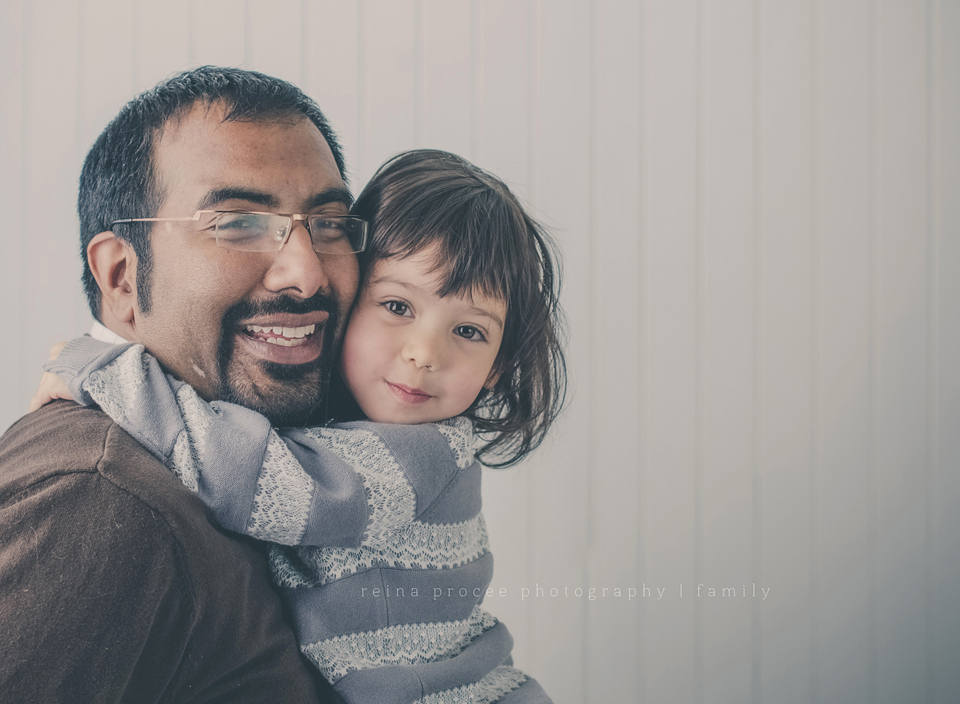father hugging three year old daughter