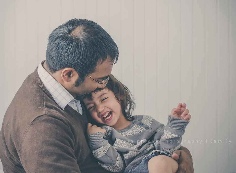 father and three year old daughter laughing