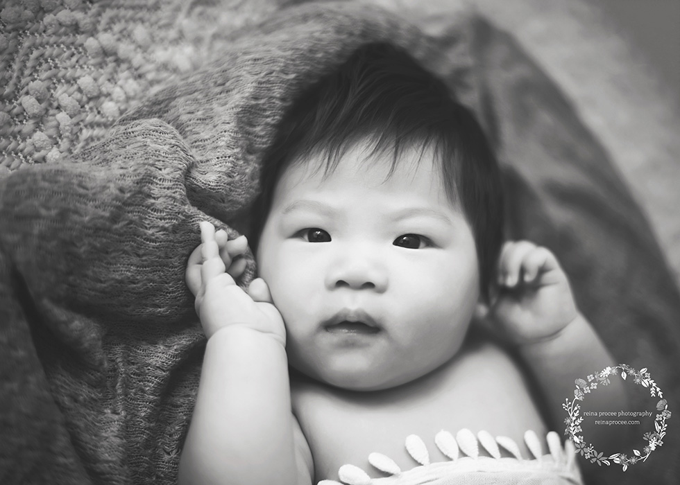 baby boy in black and white looking at camera