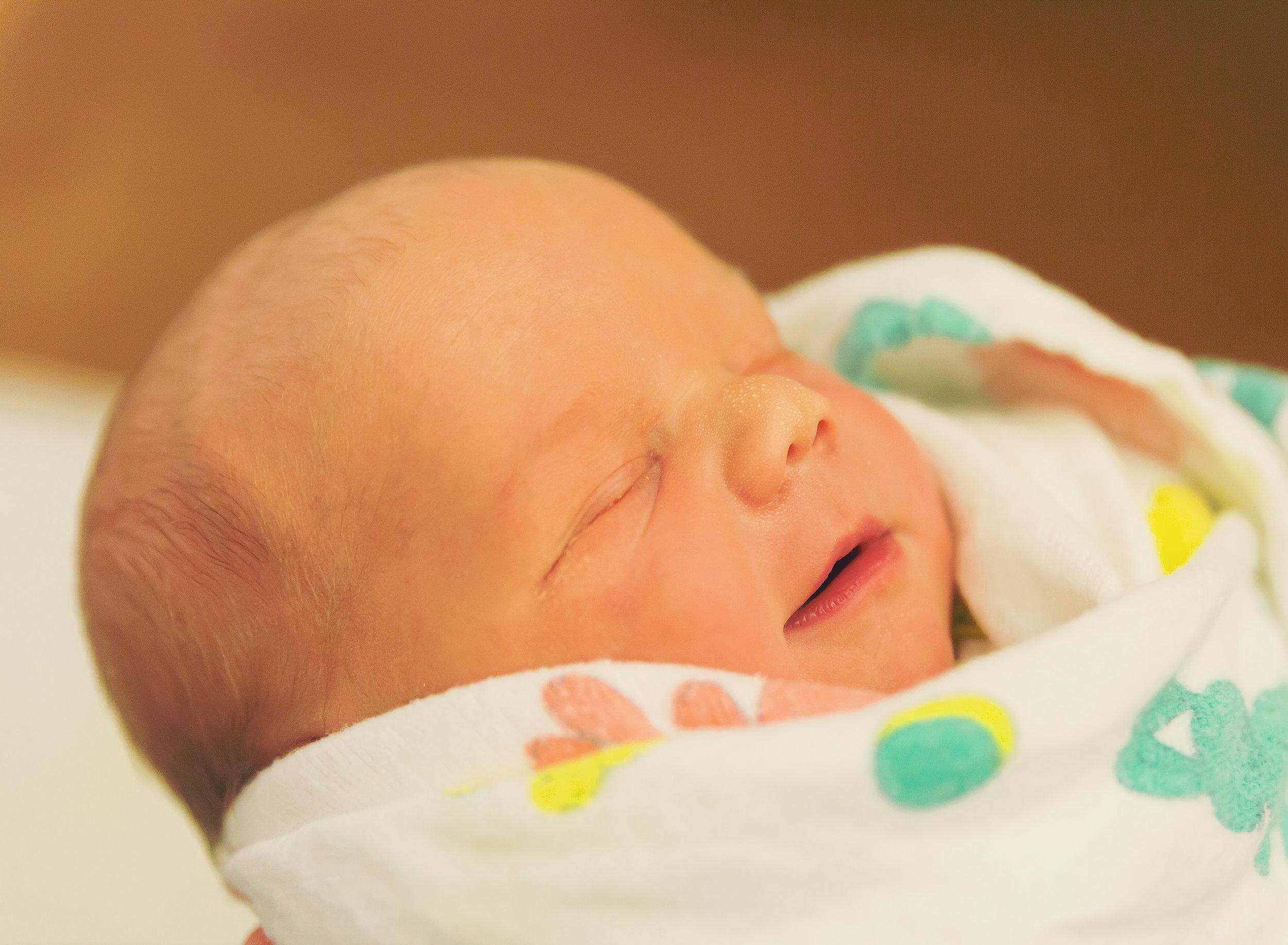 Dear Me Photography newborn boy with cute smirk