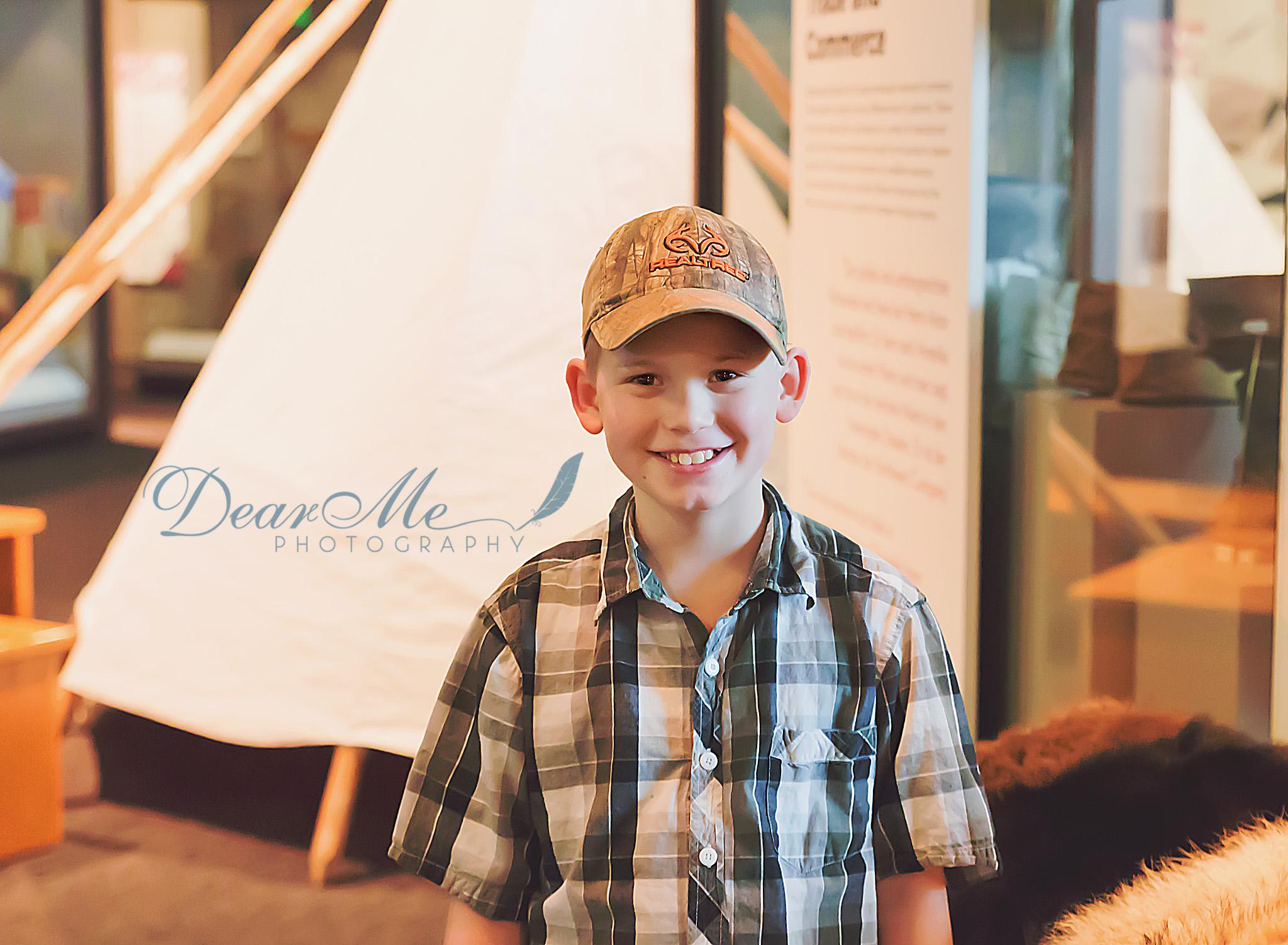 dear me photography bismarck faces of autism boy wearing baseball cap