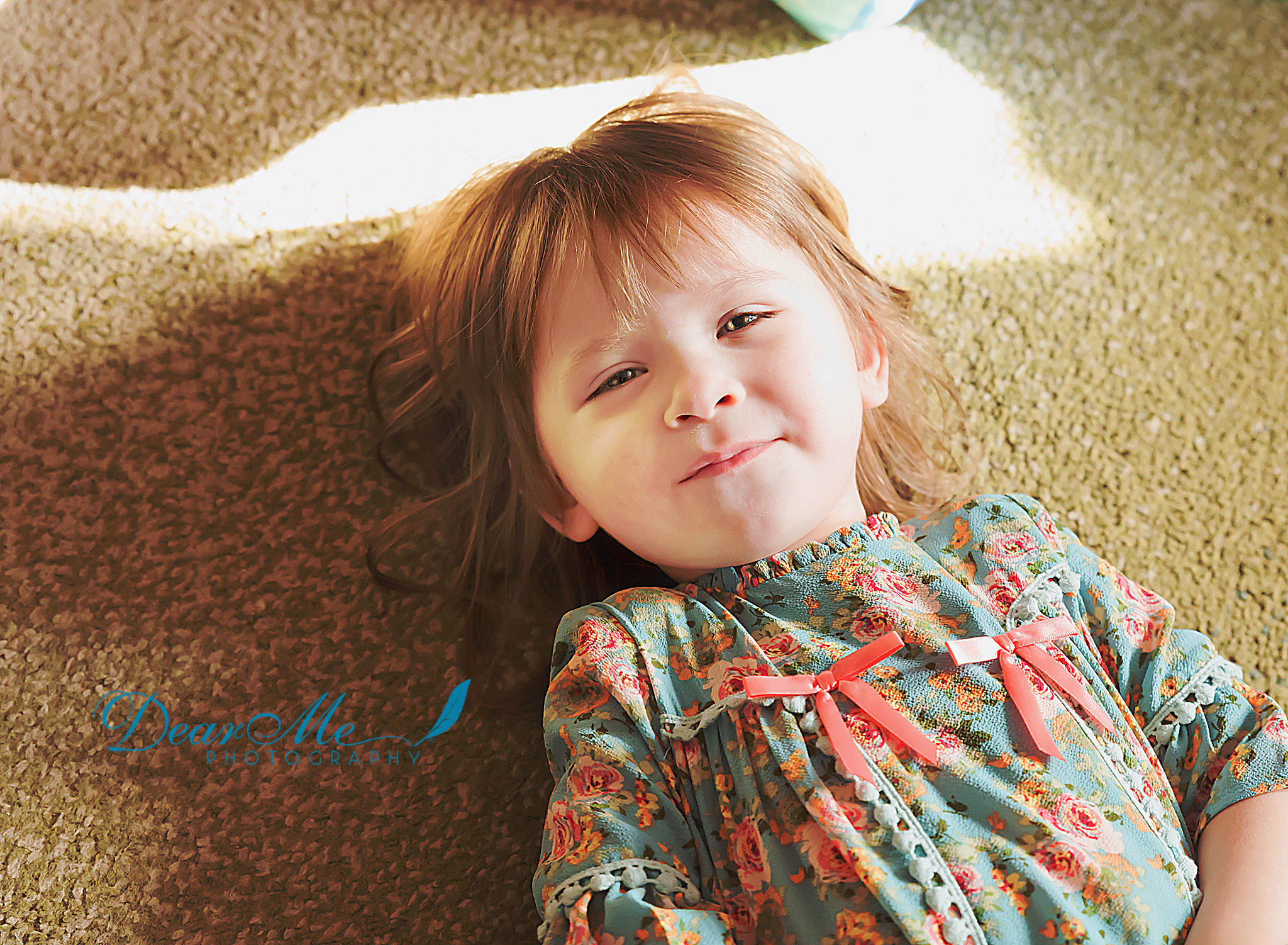 dear me photography mandan faces of autism girl on living room floor looking at camera