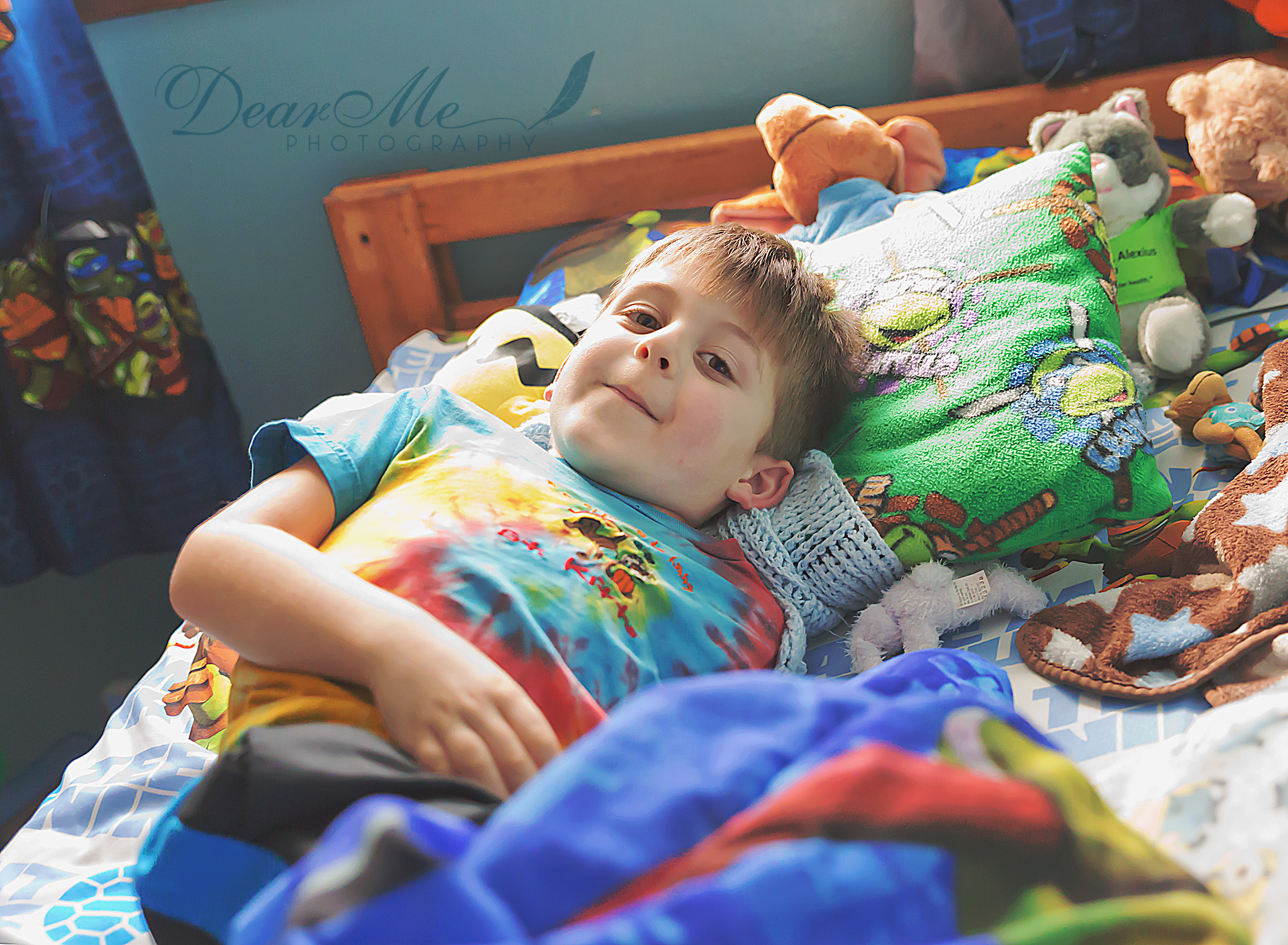 dear me photography bismarck faces of autism boy laying in his bed