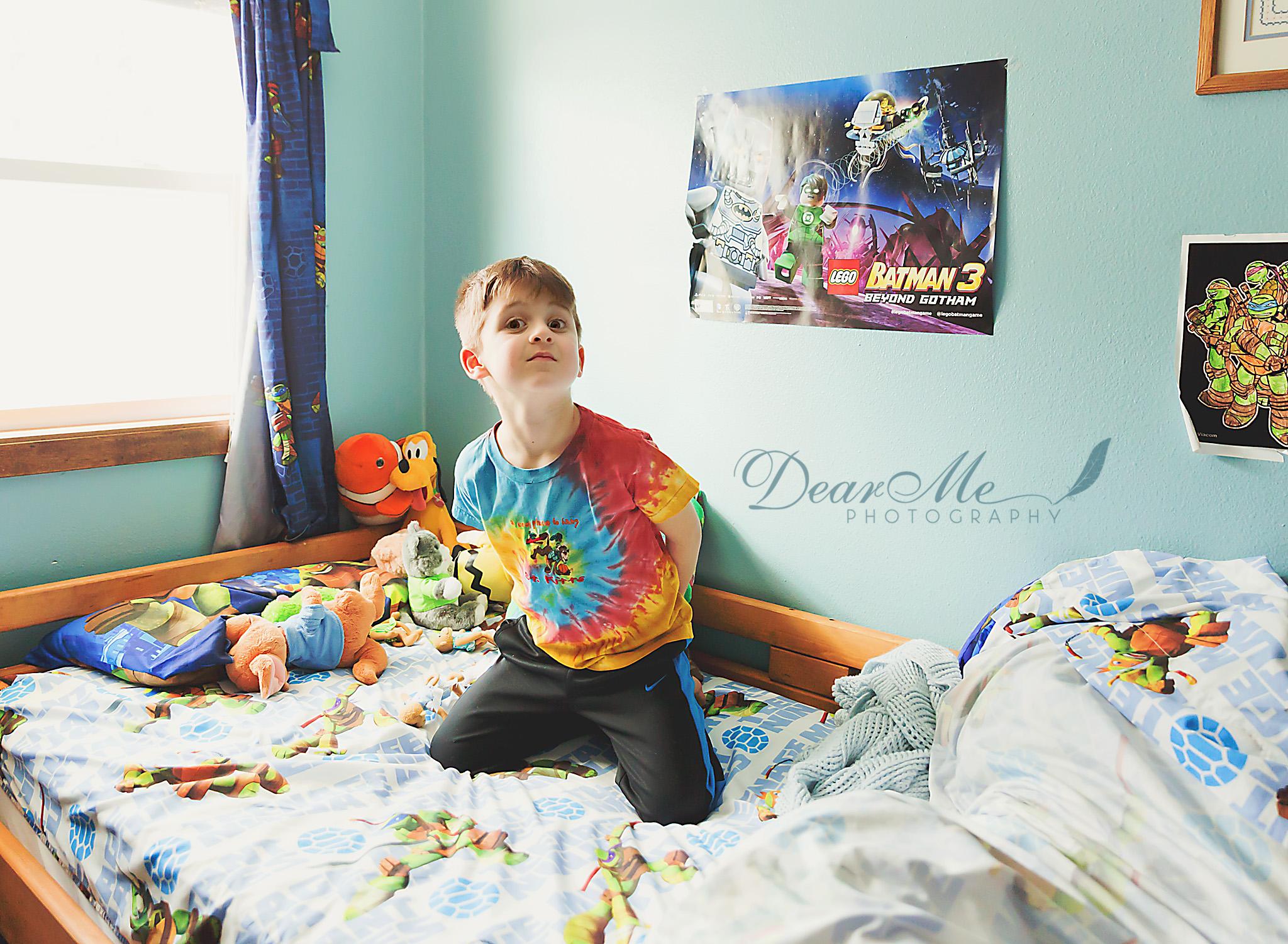 dear me photography bismarck faces of autism boy kneeling on bed