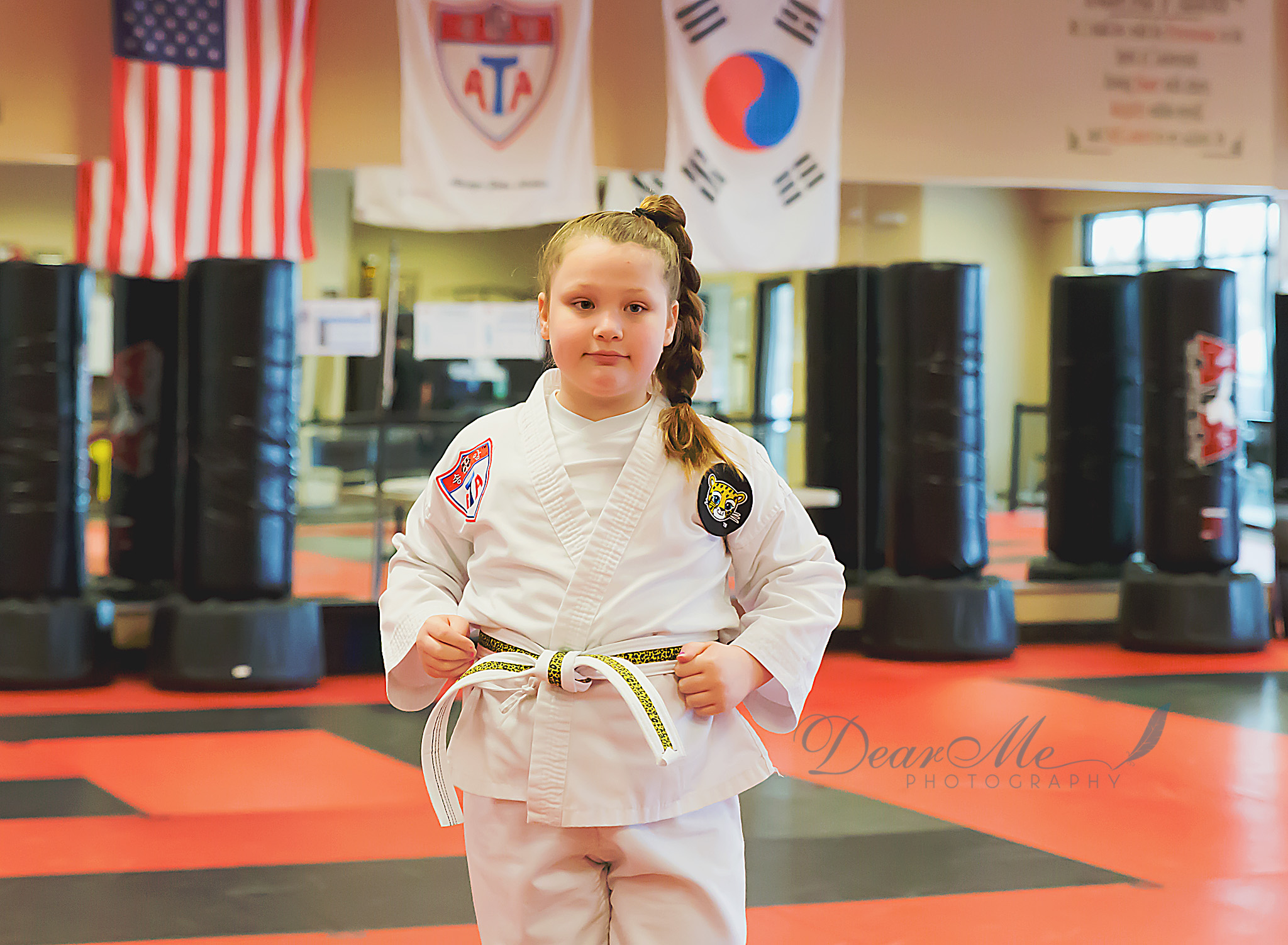 dear me photography bismarck photographer young girl with fists at hips in karate stance