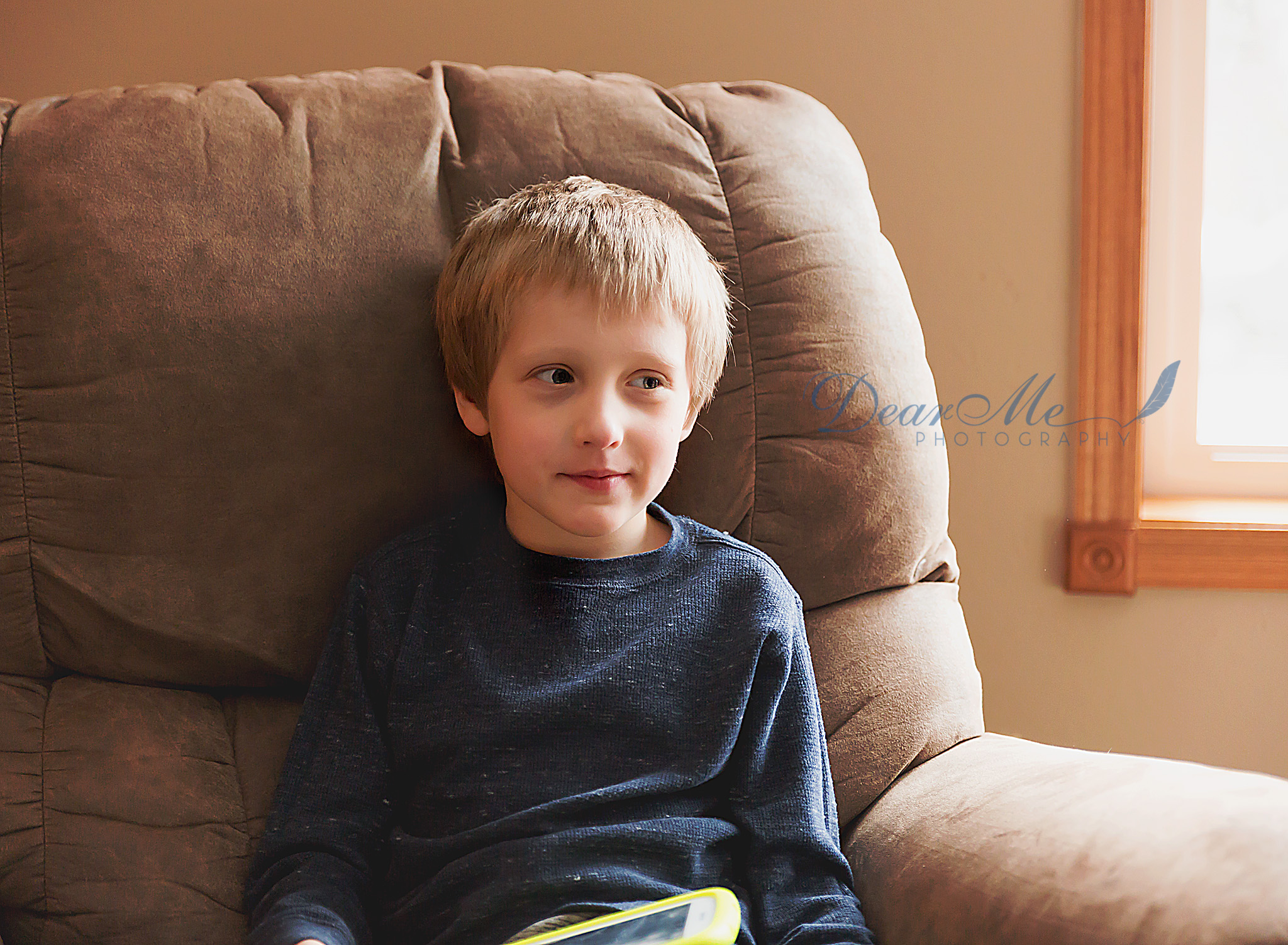dear me photography mandan photographer boy sittingy on chair looking away from camera