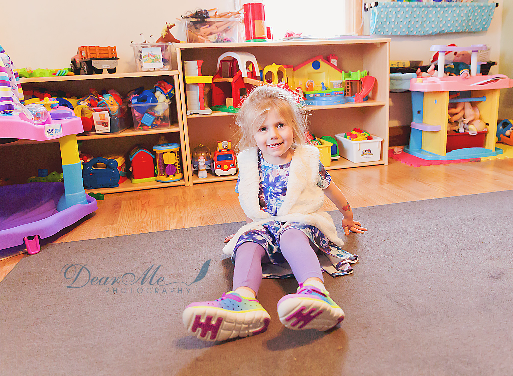 dear me photography mandan nd photographer girl sitting on rug in front of toys