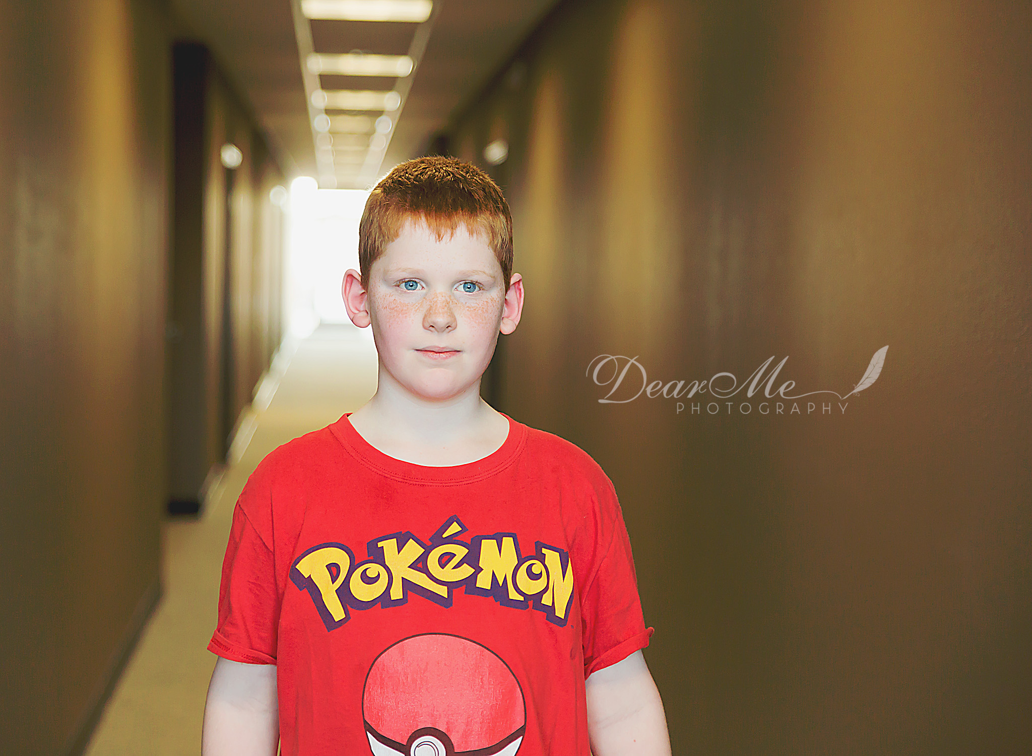 dear me photography bismarck child photographer boy standing in hallway looking just past the camera