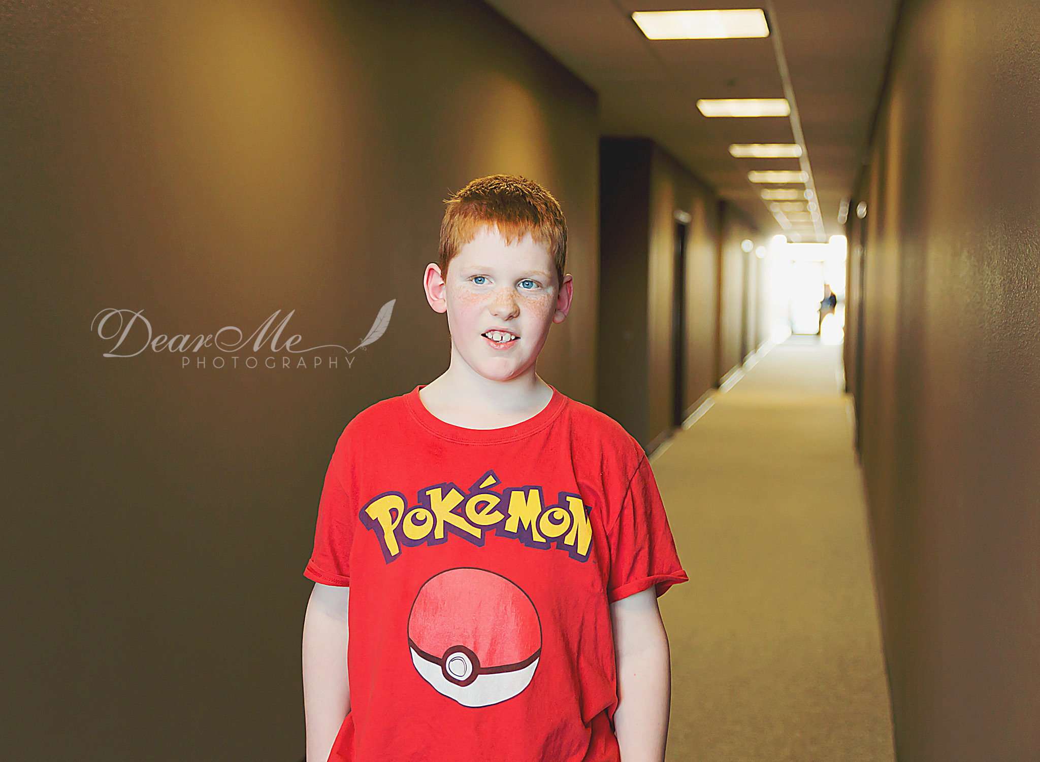 dear me photography bismarck photographer boy in red shirt standing in hallway